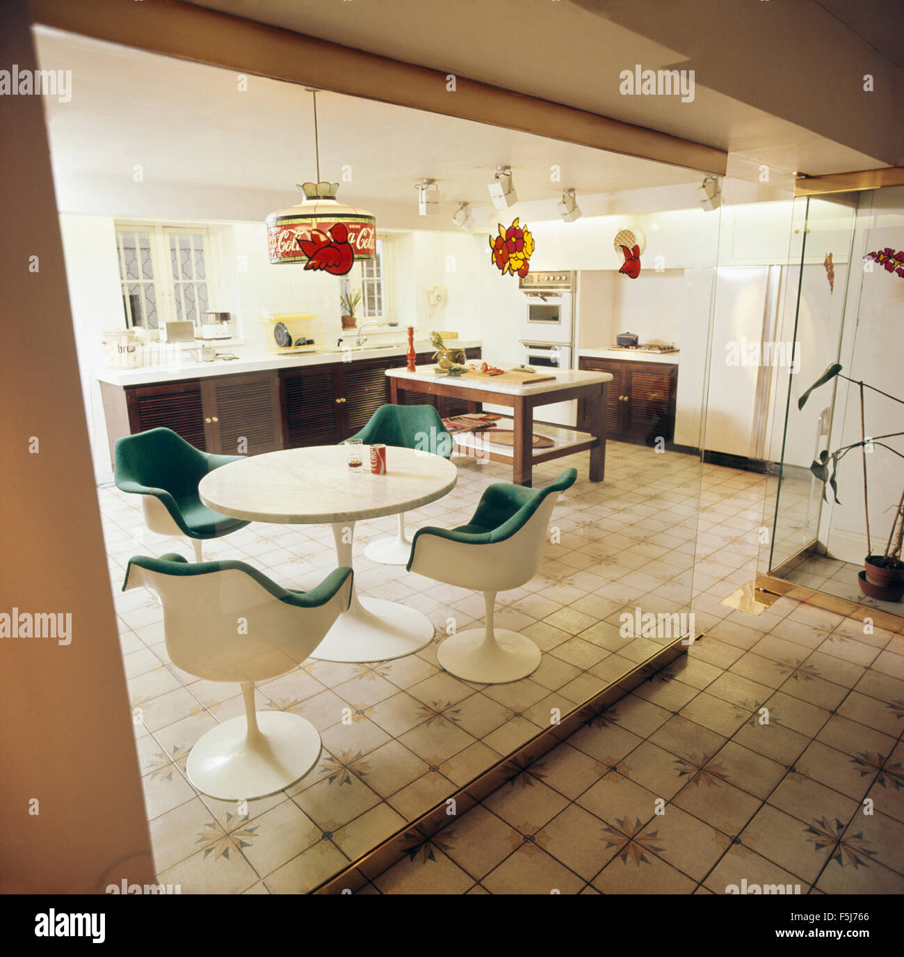 Eero Saarinen Tulip Table And Chairs In Seventies Kitchen With Glass Wall  Divider
