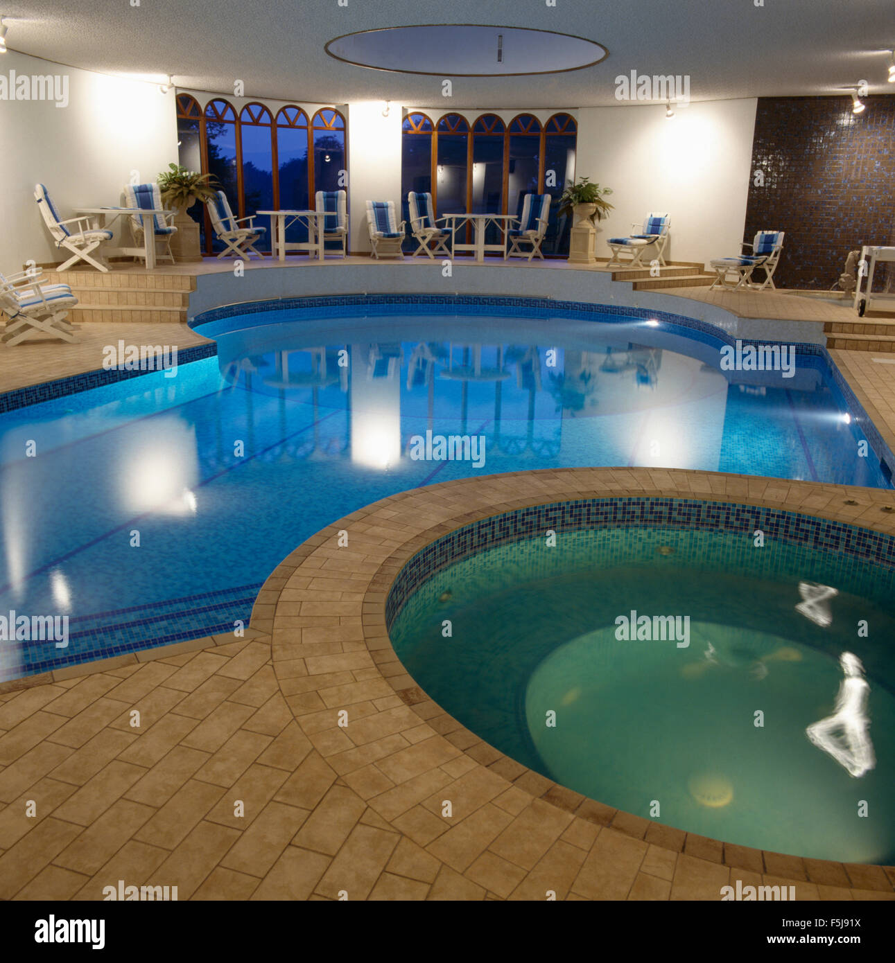 Eighties private indoor swimming pool with a Jacuzzi tub Stock Photo ...
