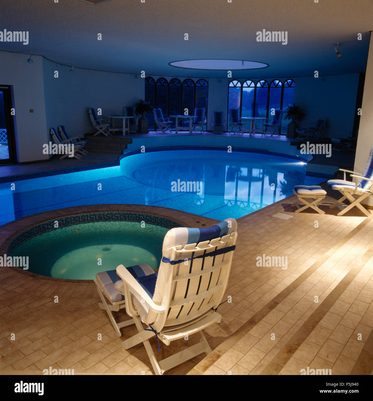 Private Indoor Swimming Pools white loungers beside spa tub and eighties private indoor swimming