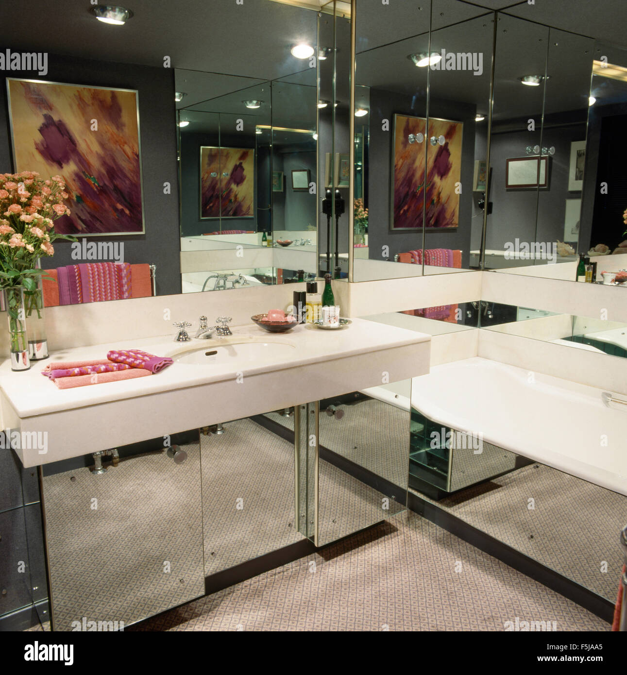 Mirrored walls and bath panel in eighties bathroom with a mirrored mirrored walls and bath panel in eighties bathroom with a mirrored vanity unit amipublicfo Choice Image