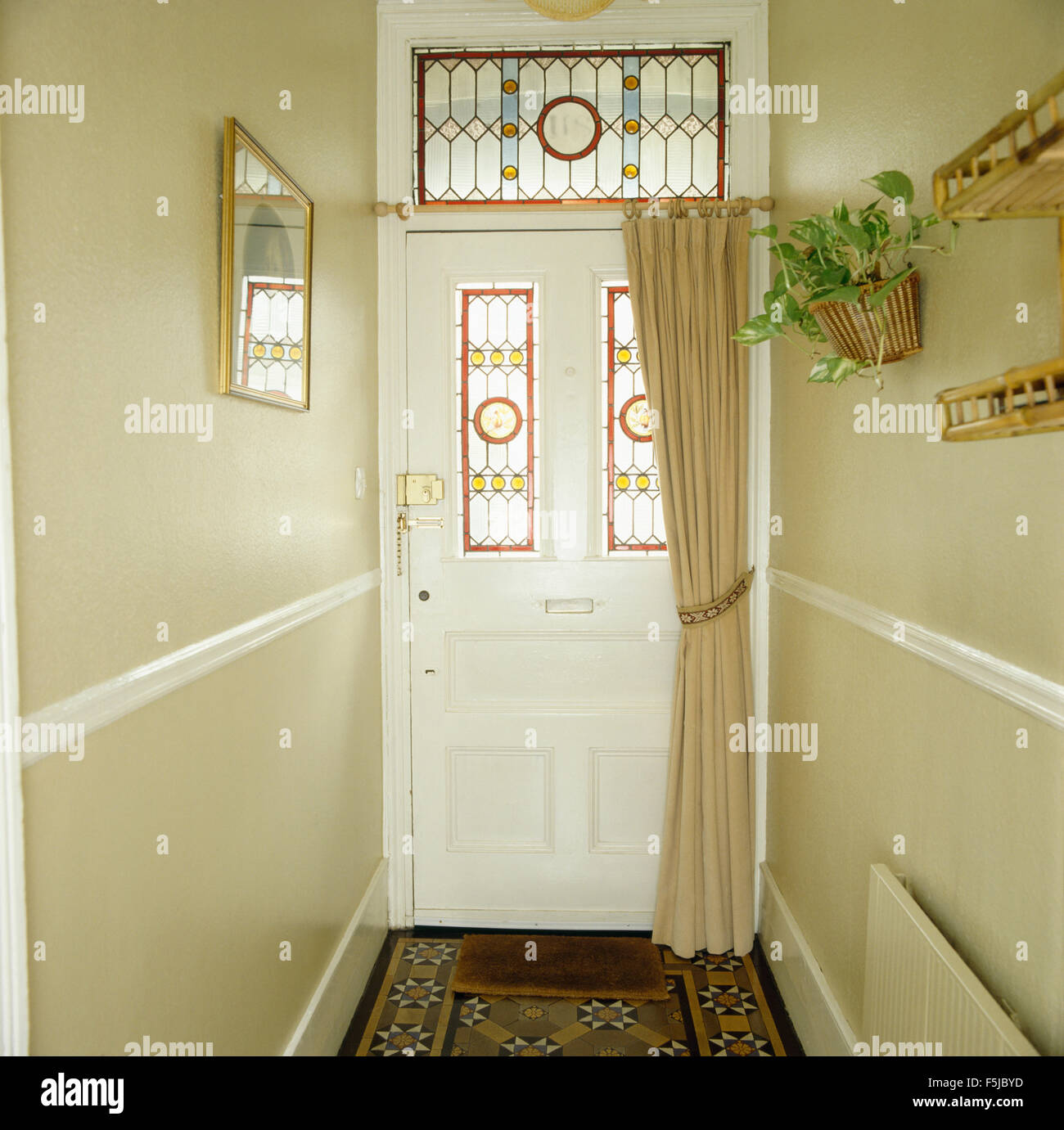 curtain for front doorStained glass panels in front door with acream curtain in Stock