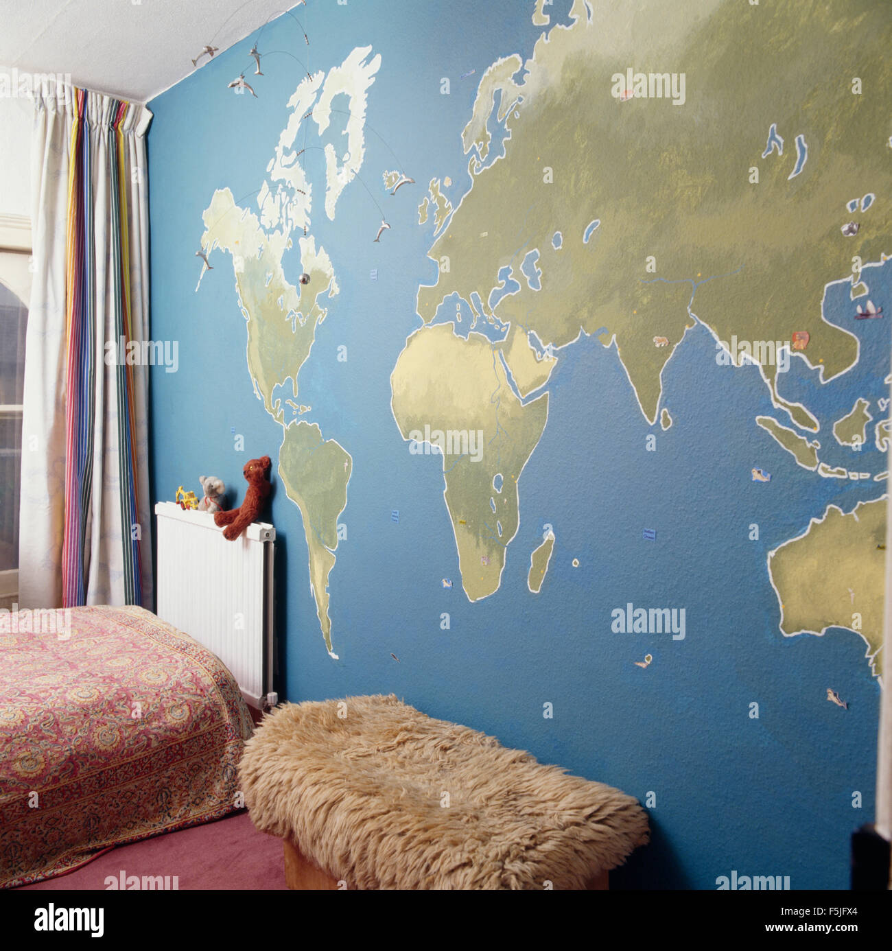 World map on old wall stock photos world map on old wall stock map of the world painted on wall in a childs seventies bedroom stock image gumiabroncs Images