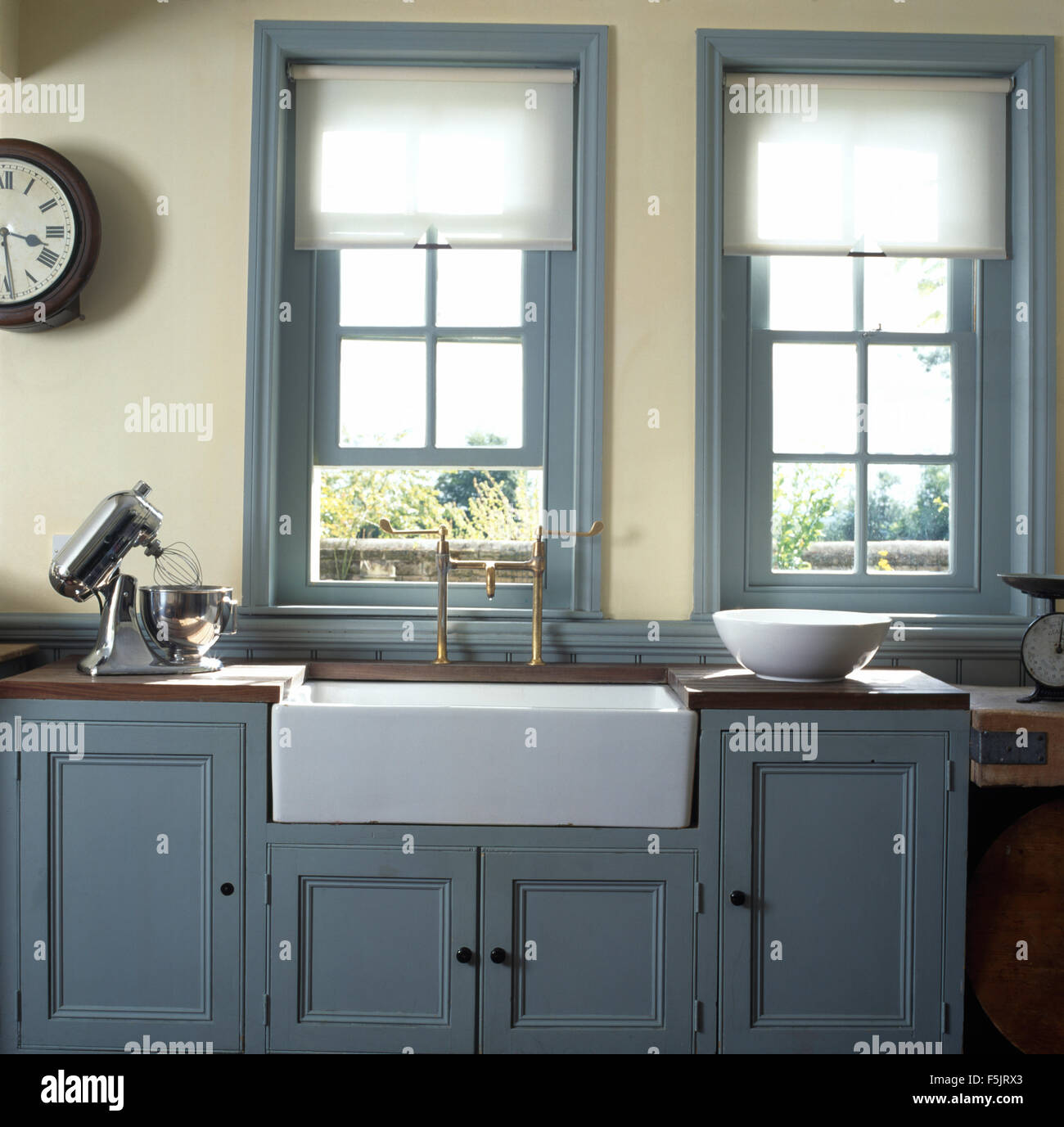 Bathroom Window Above Sink white blinds on windows above belfast sink in kitchen with pale