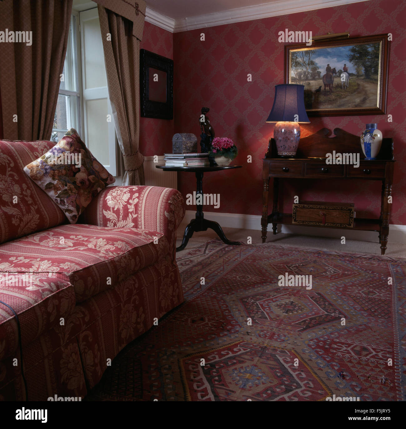 Red patterned wallpaper and red sofa in a nineties living for Red living room wallpaper