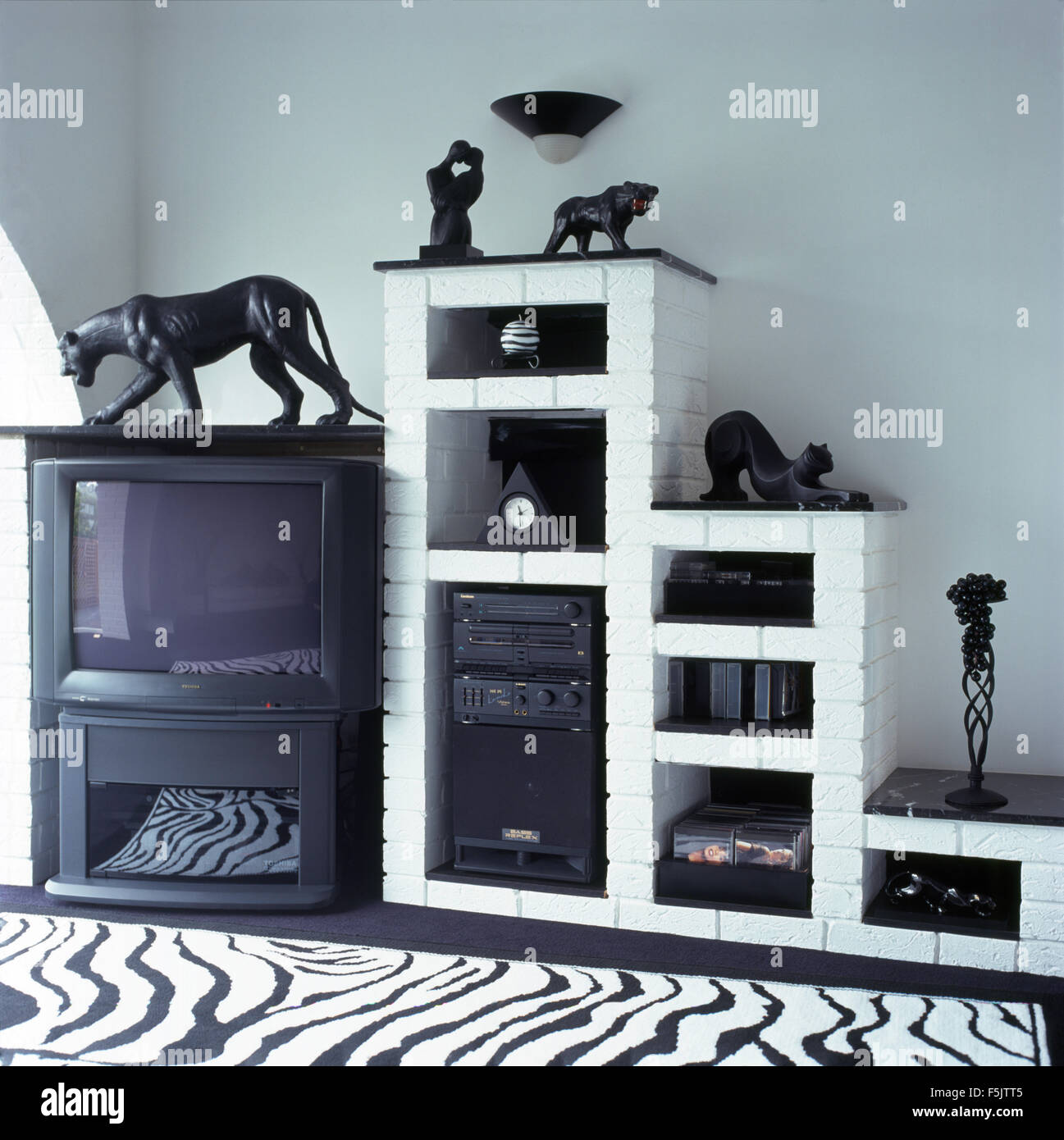 Music Living Room Television And Music System On White Painted Brick Shelving In A