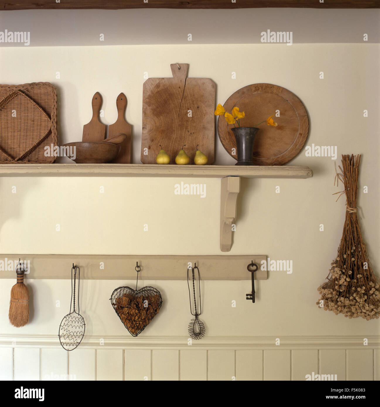 Shaker Style Kitchen Wooden Breadboards On Simple Shelves In Shaker Style Kitchen Stock