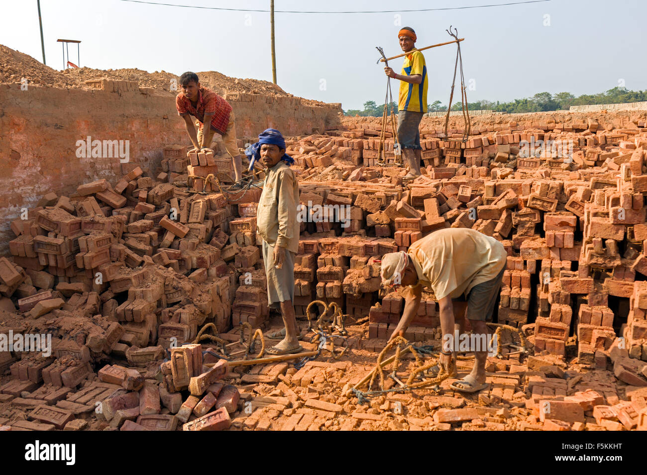 Burnt Clay Brick : Workers are taking out burnt clay bricks of the kiln a