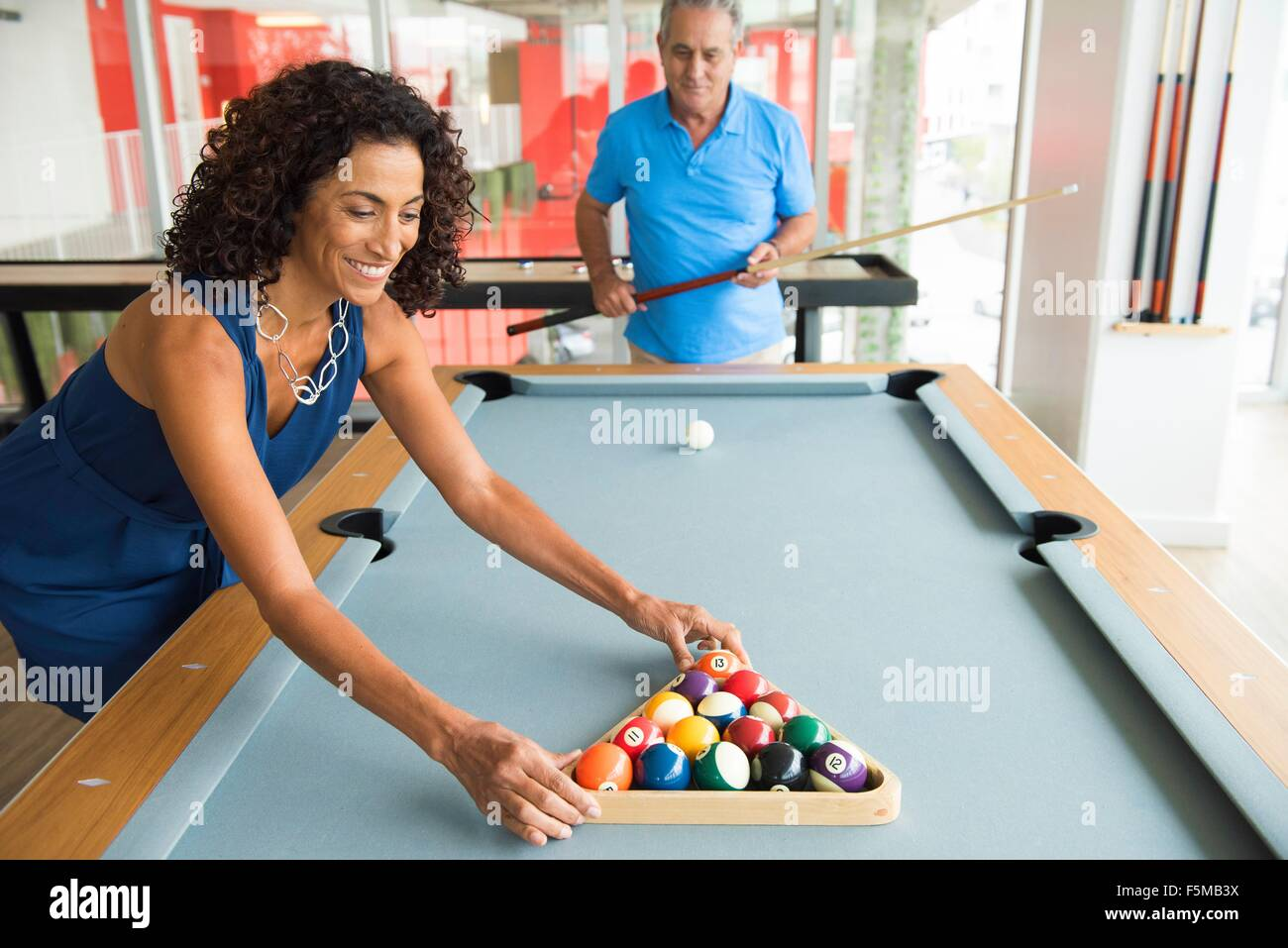 Setting Up A Pool Table Senior Man And Wife Setting Up Pool Table Stock Photo Royalty