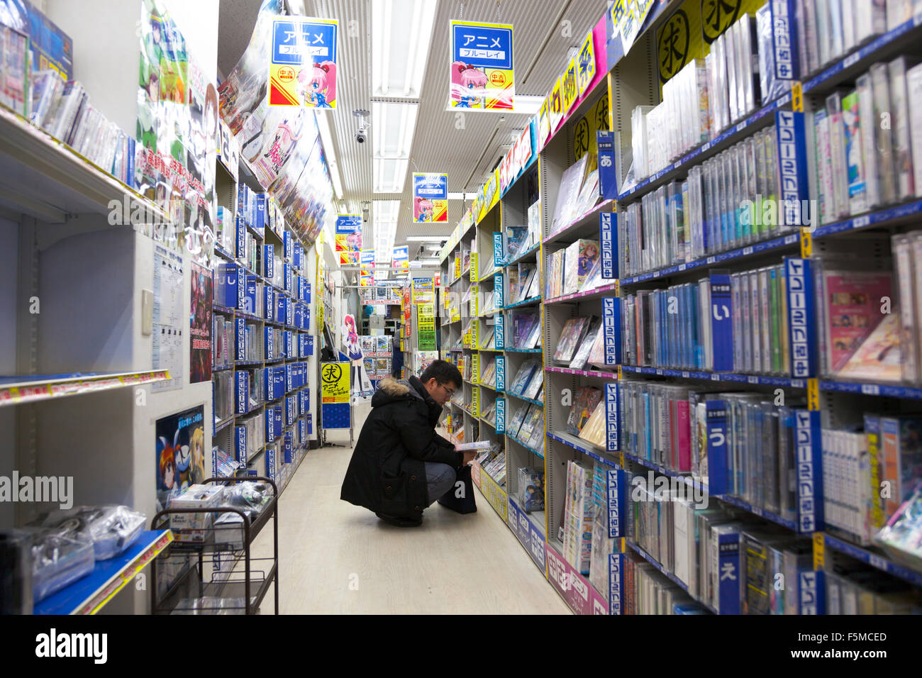 man looking at books in a manga and anime store in the akihabara stock photo 89573973 alamy. Black Bedroom Furniture Sets. Home Design Ideas