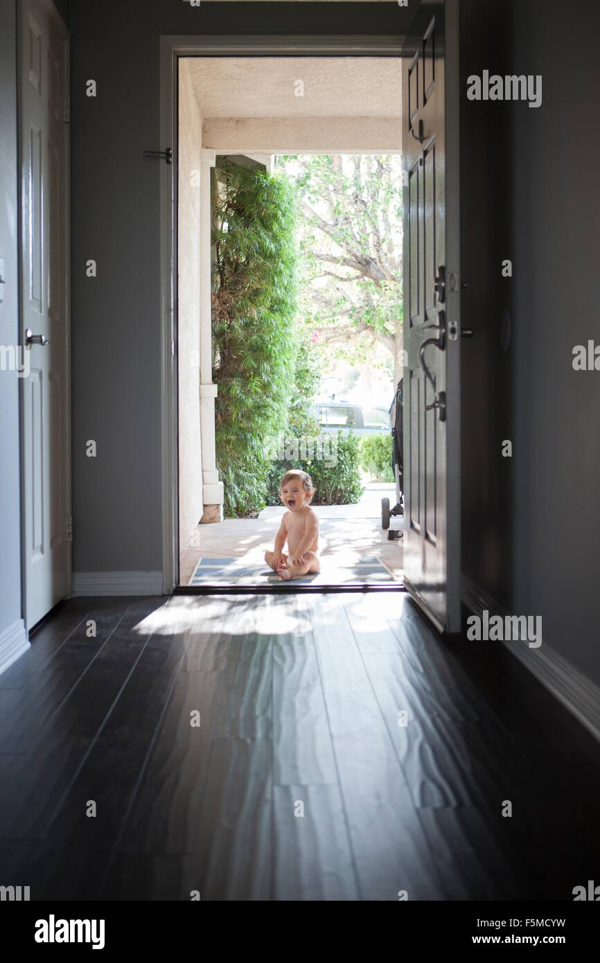 Front door camera - Stock Photo View Through Entrance Hall Of Baby Boy Sitting Outside At Open Front Door Looking At Camera Open Mouthed