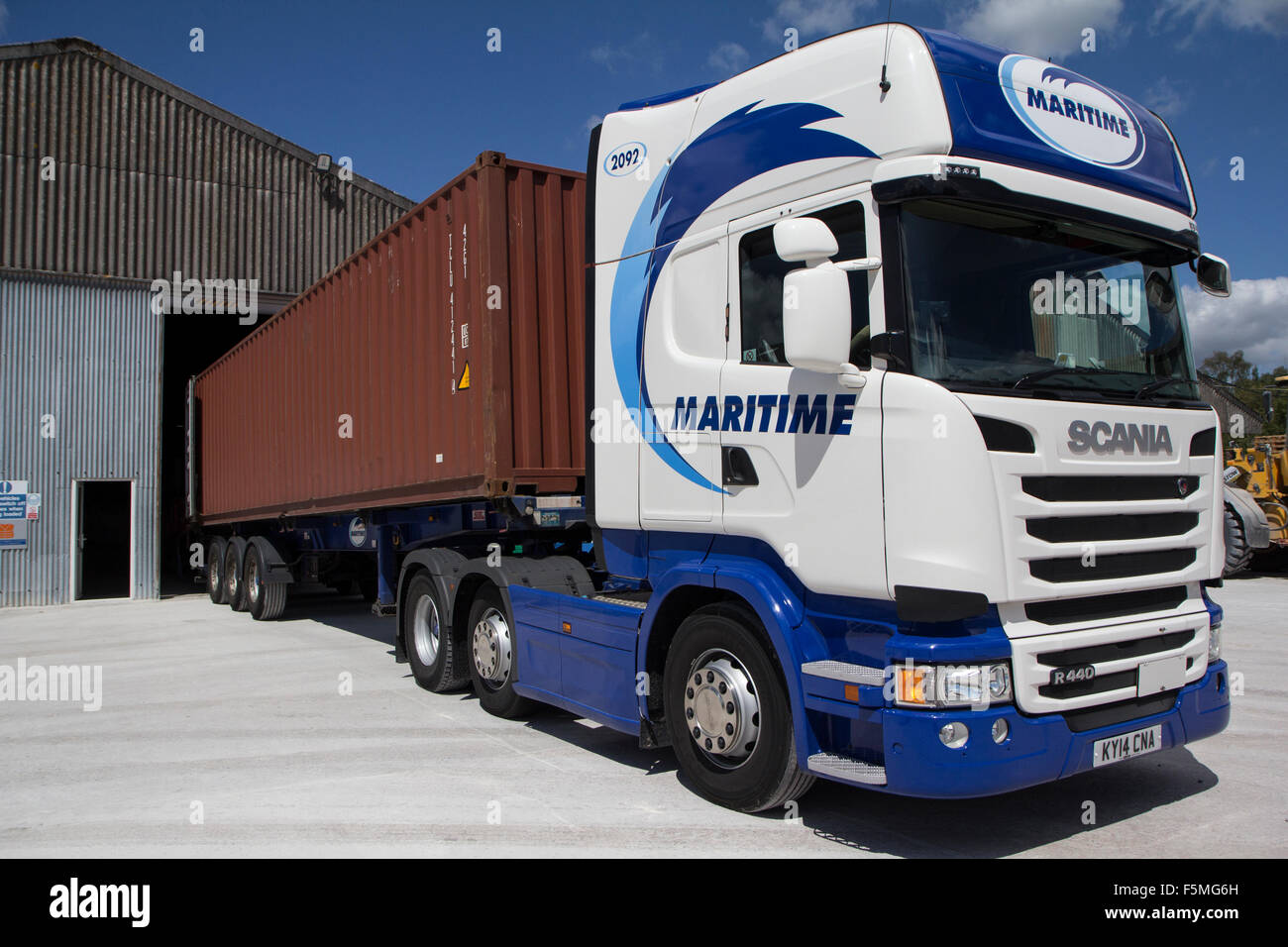 an articulated lorry with a 40 ft shipping container at a loading stock photo royalty free. Black Bedroom Furniture Sets. Home Design Ideas