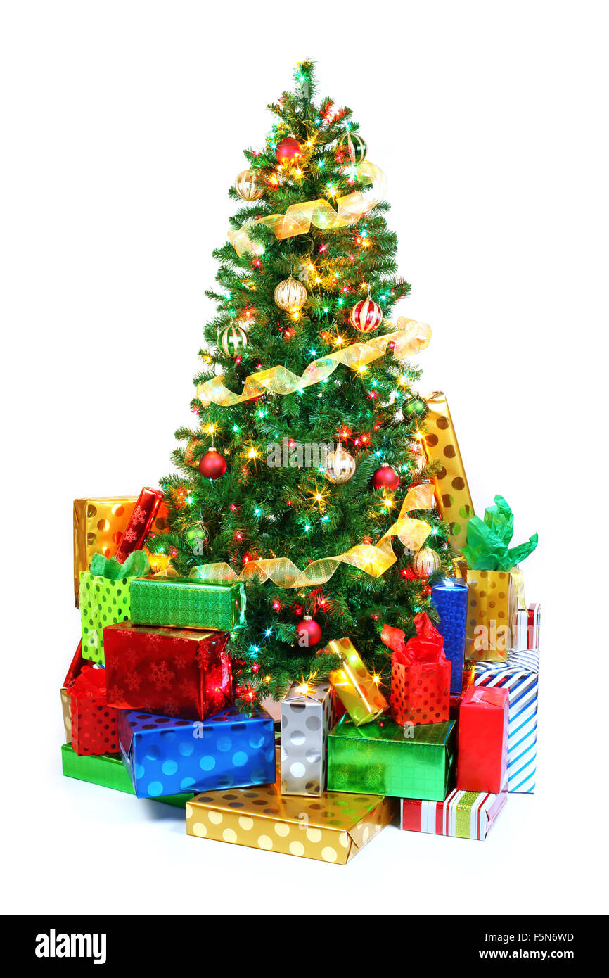 Decorated Christmas tree surrounded by colorful presents. Isolated ...