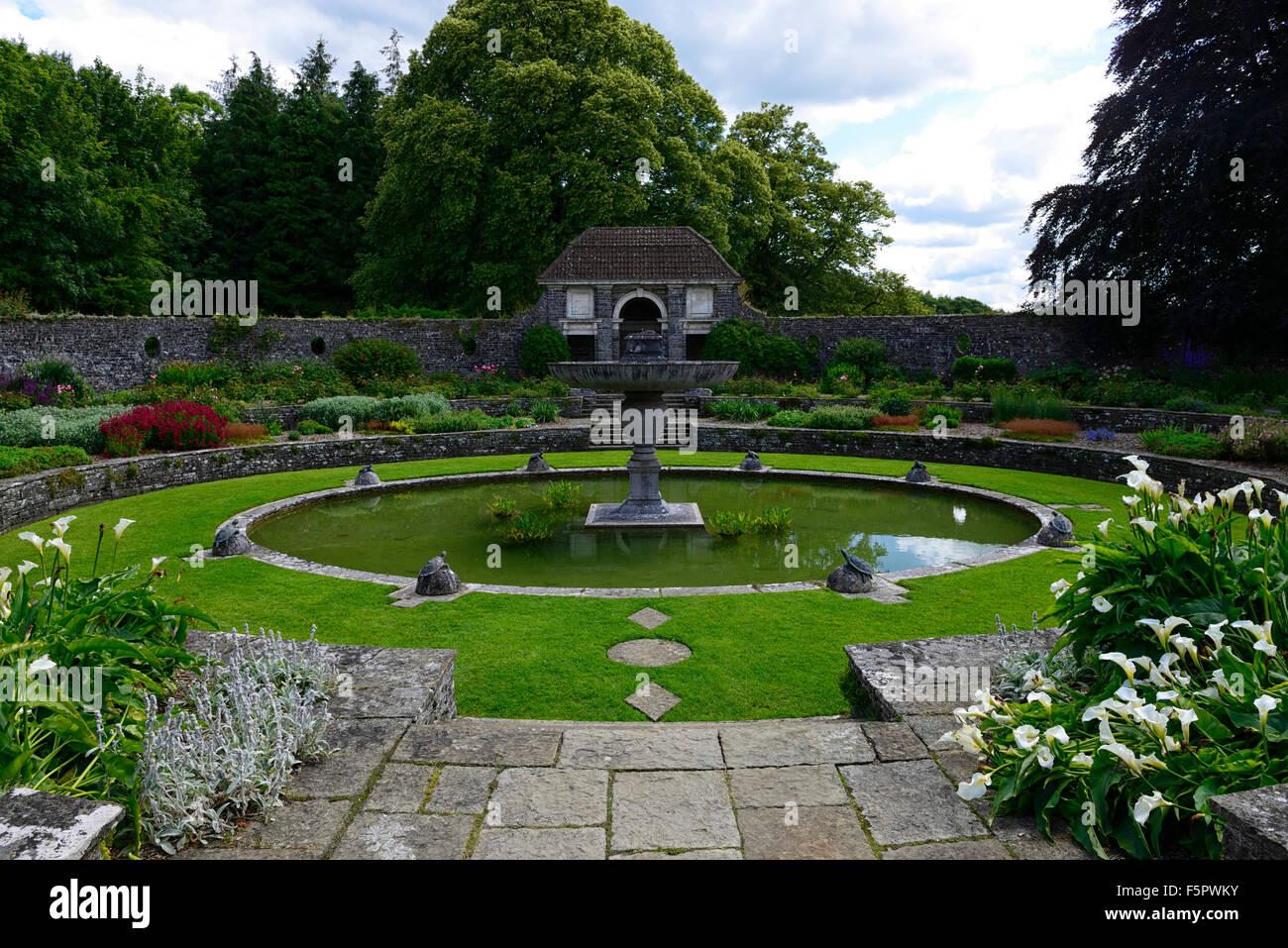 Sunken round oval pond garden heywood gardens garden for Round garden pond designs