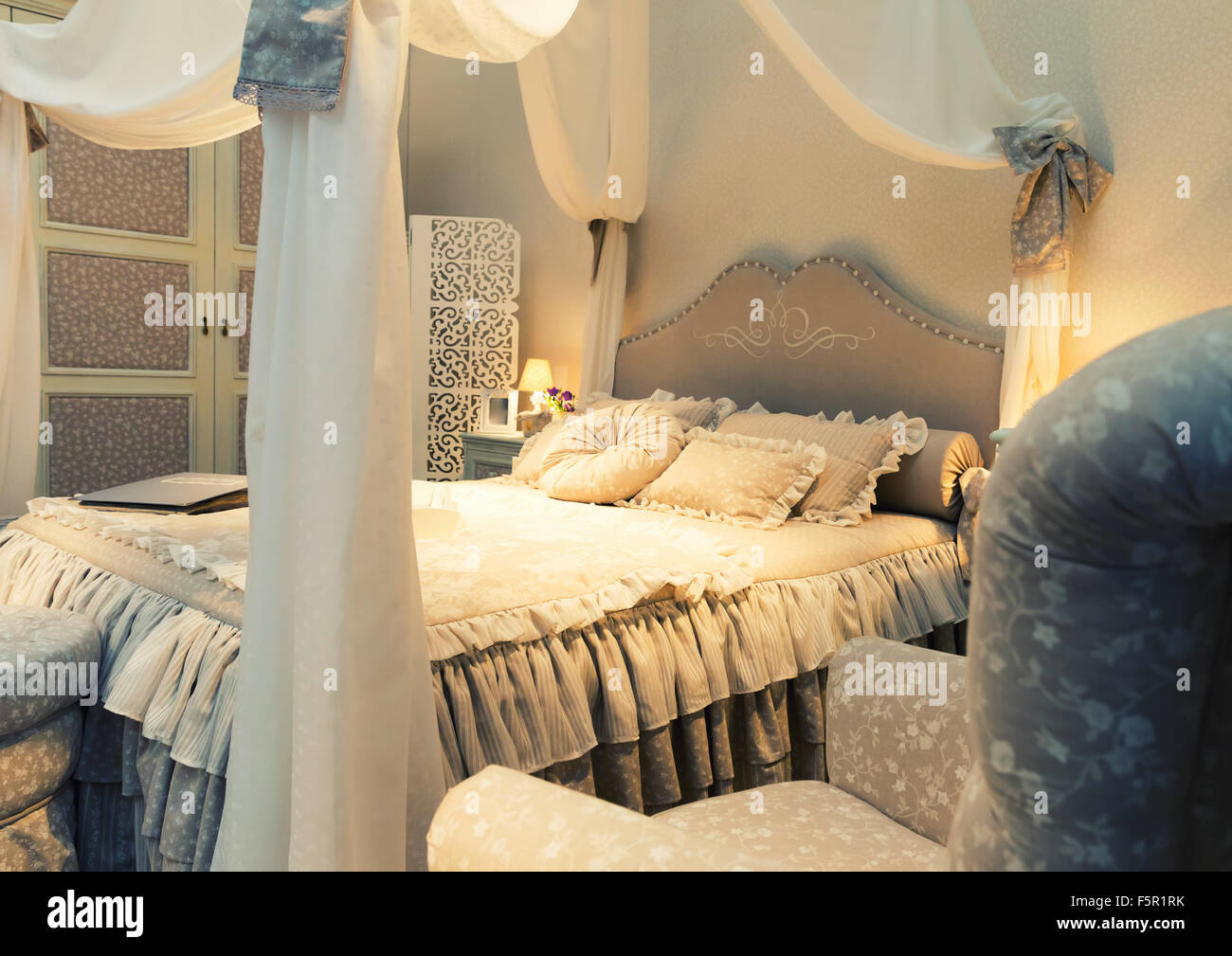 Nice luxury big white bed with pillows in a bedroom Stock Photo ...