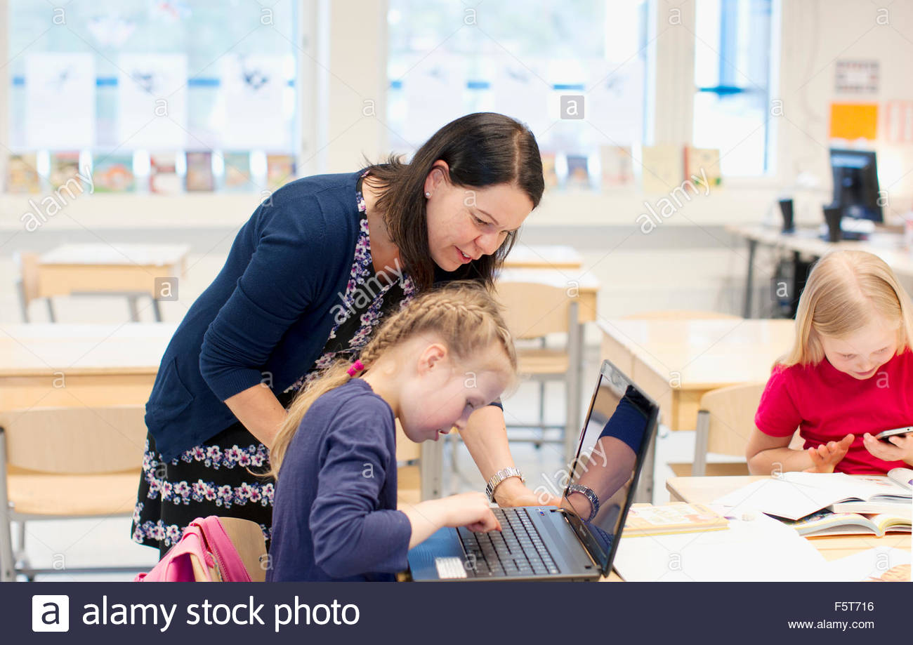 Finland, Girls (8-9) and teacher in classroom Stock Photo, Royalty ...