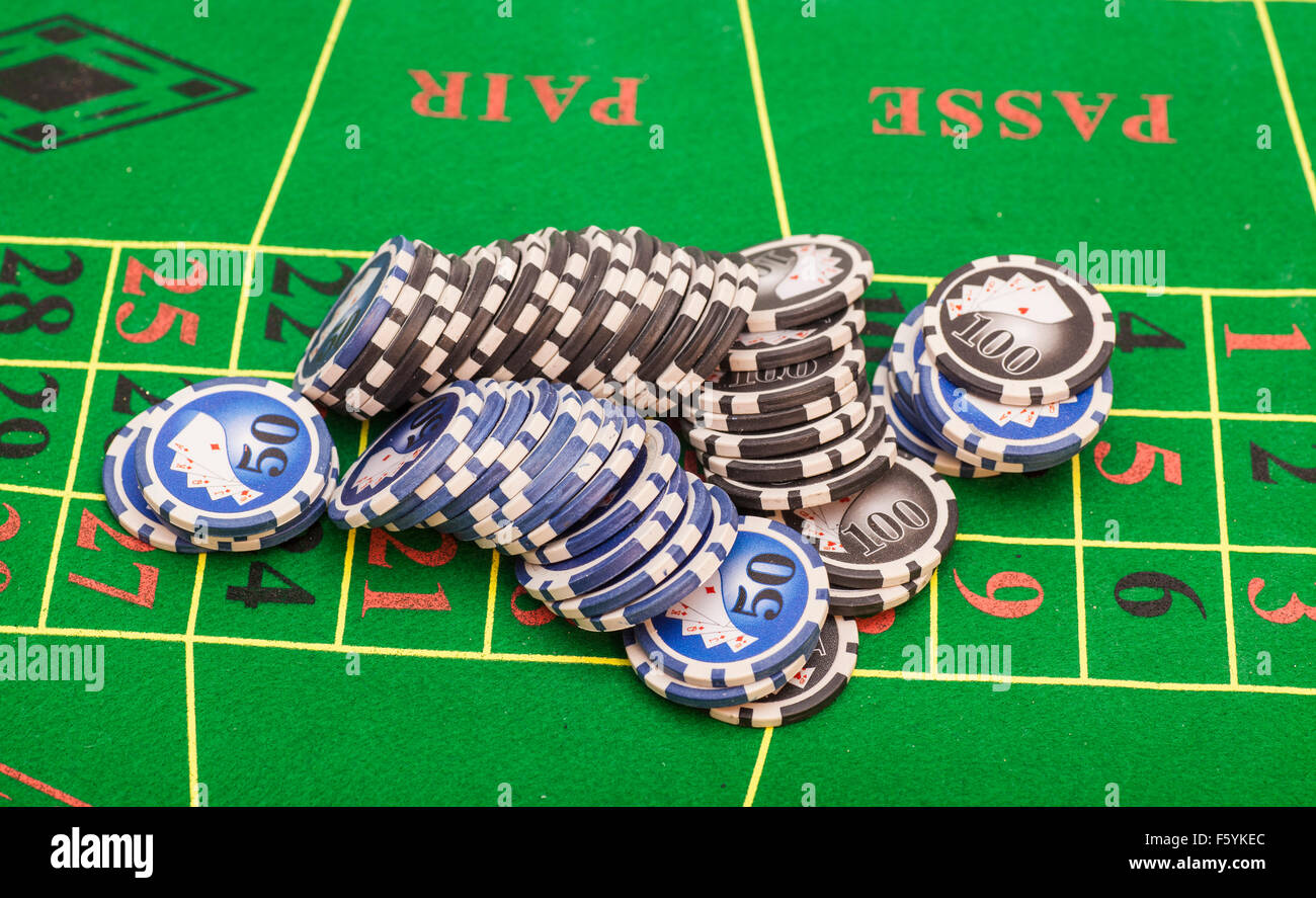Casino Chips On Green Felt Game Table In A Casino