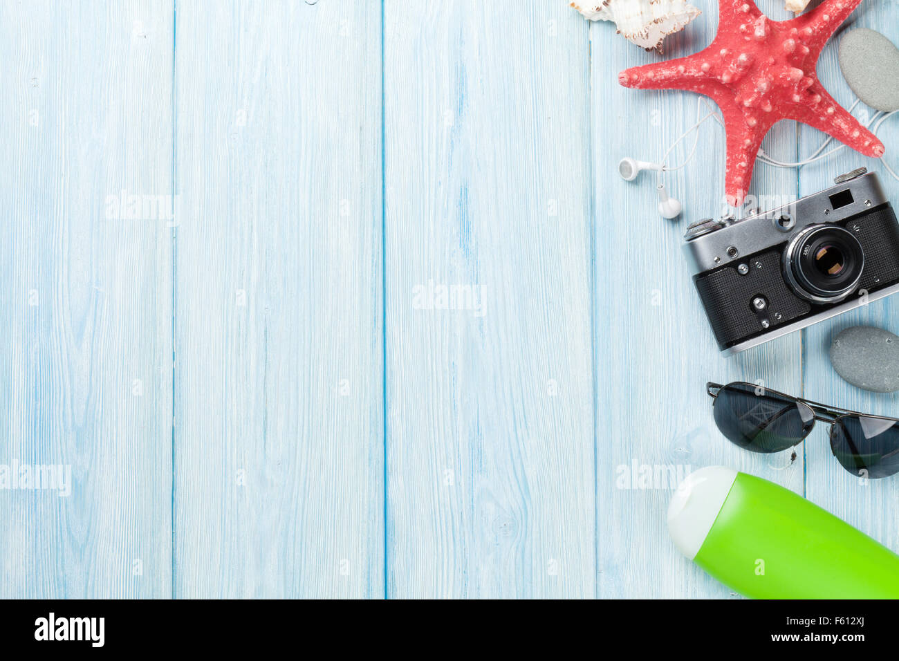 Travel and vacation background with items over wooden table Top