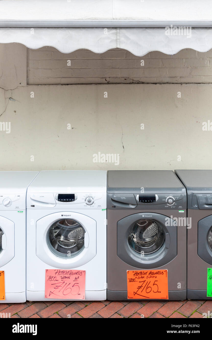 second hand washing machines for sale on a uk town centre street
