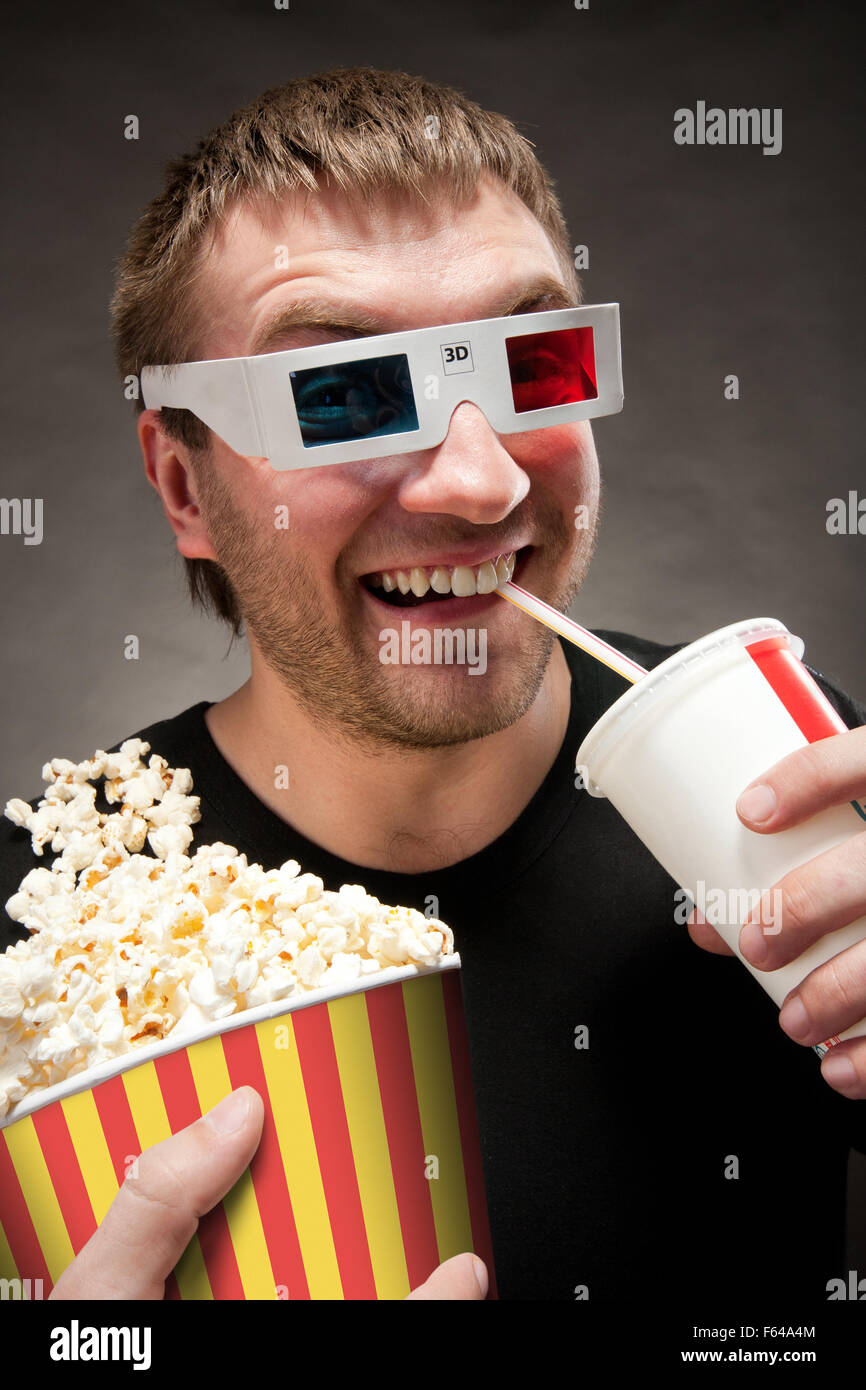 funny man watching 3d movie drinking soda and eating popcorn F64A4M funny man watching 3d movie, drinking soda and eating popcorn,Popcorn Eating Meme