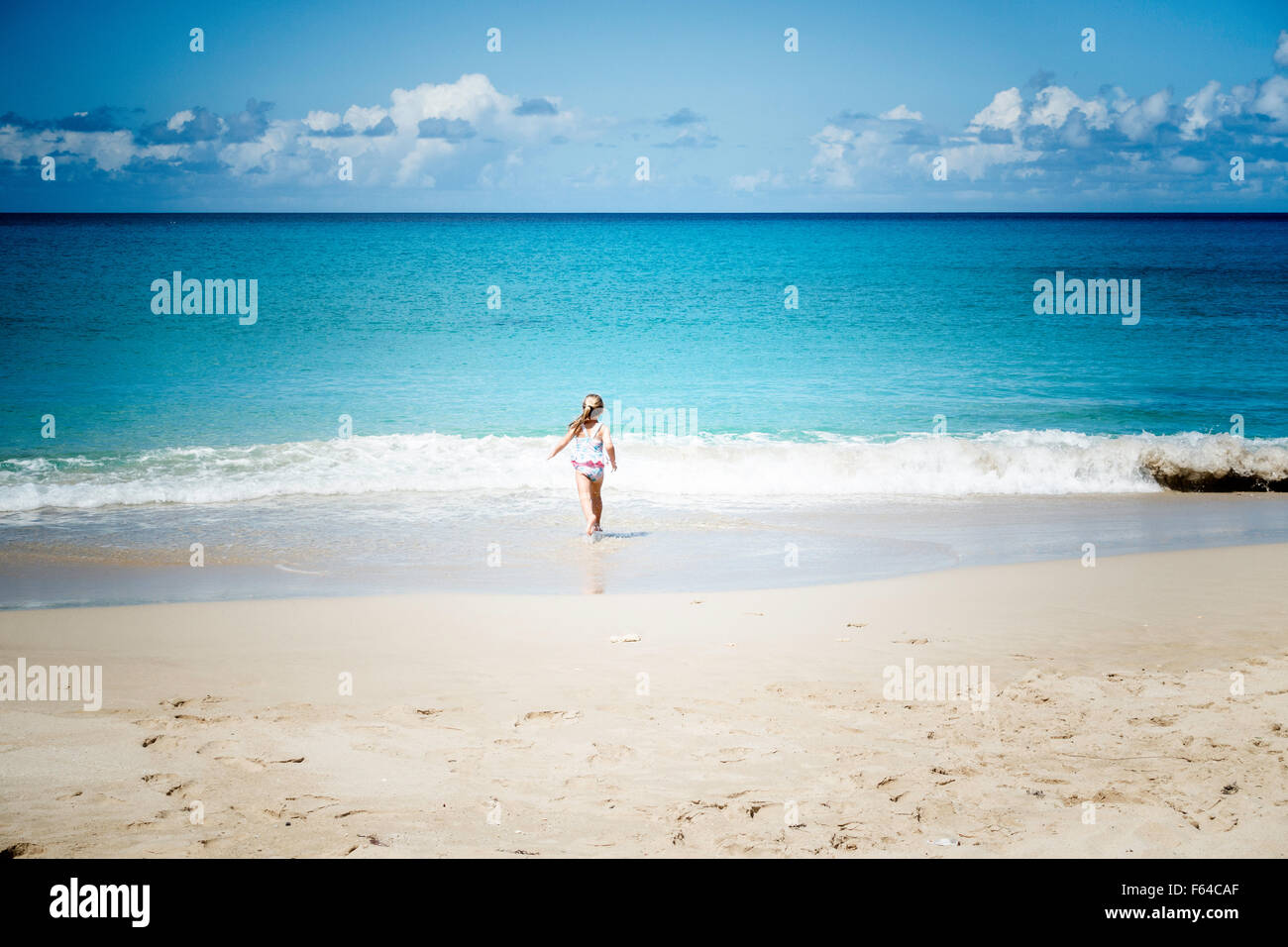 a-four-year-old-caucasian-girl-plays-on-the-beach-at-st-croix-us-virgin-F64CAF.jpg