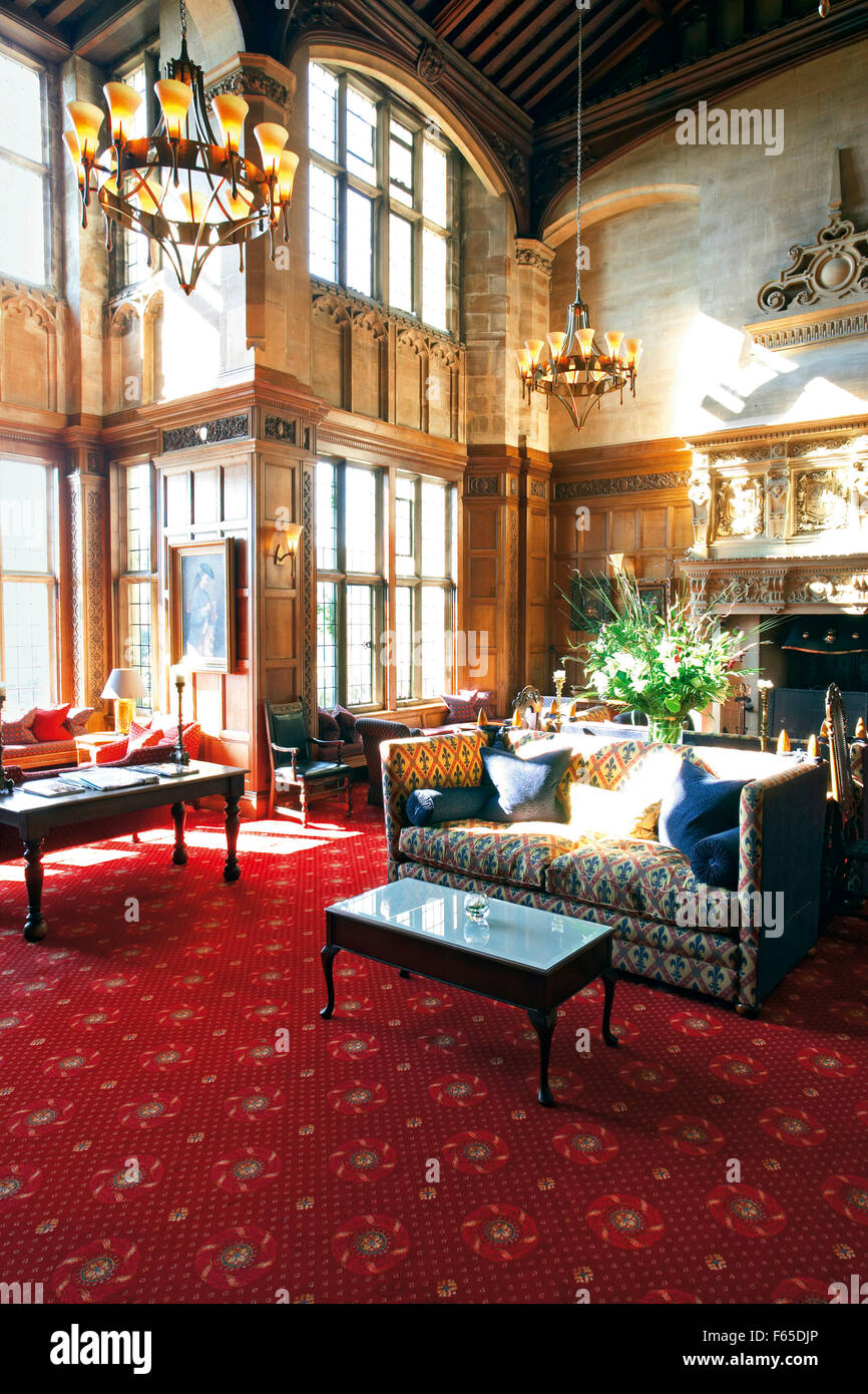 fireplace room in hotel bovey castle with chandeliers, red carpet