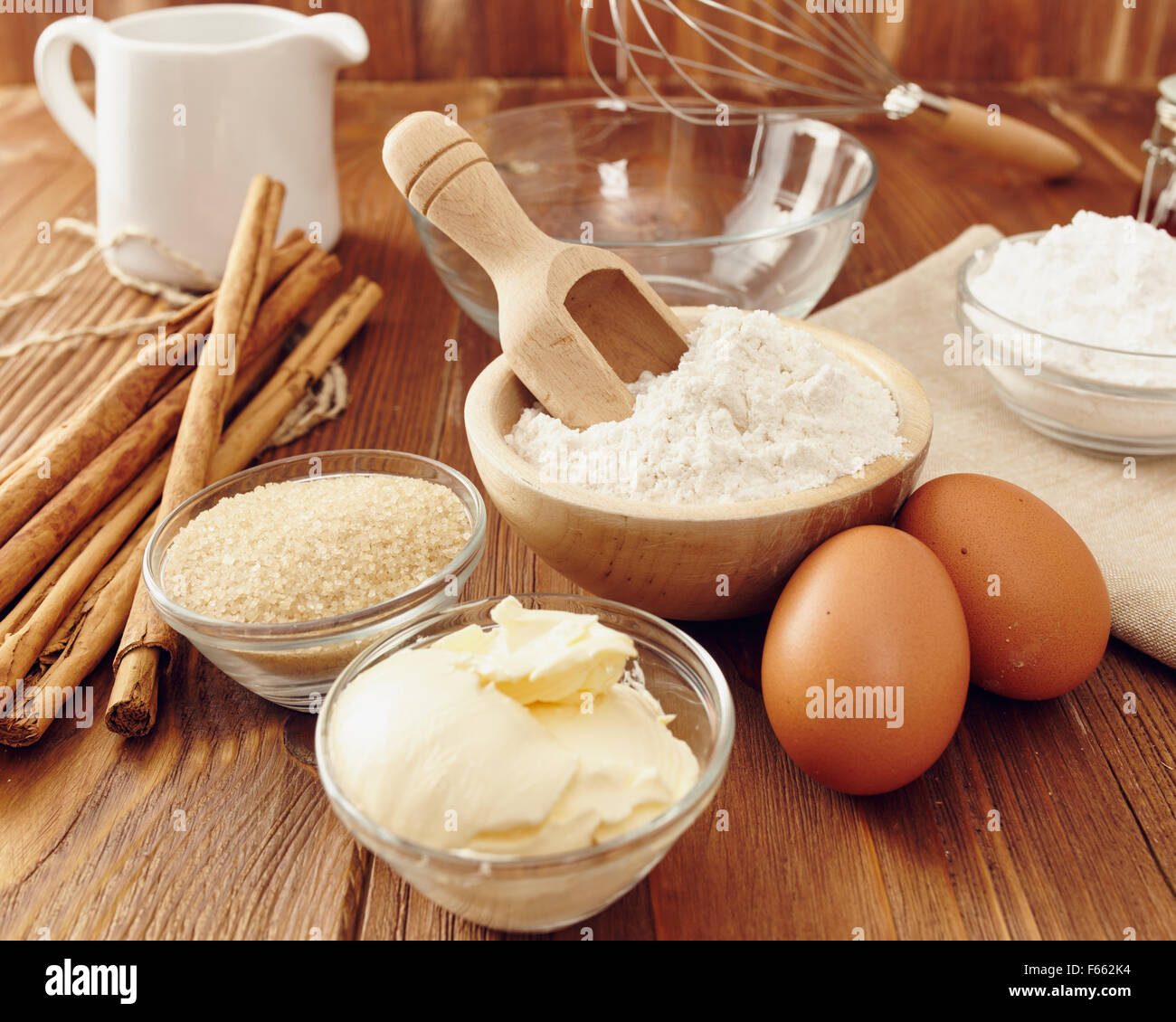 Ingredients to make a cake or a dessert on an aged wooden for What are the ingredients to make a cake