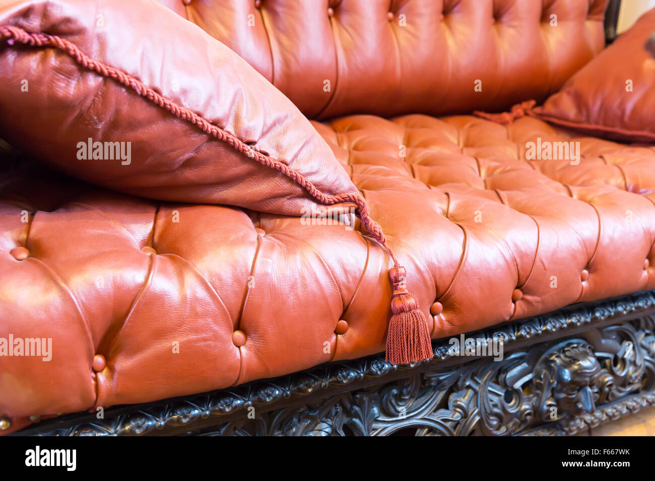 Macro of luxuroius leather-covered sofa with a pillow Stock Photo ...