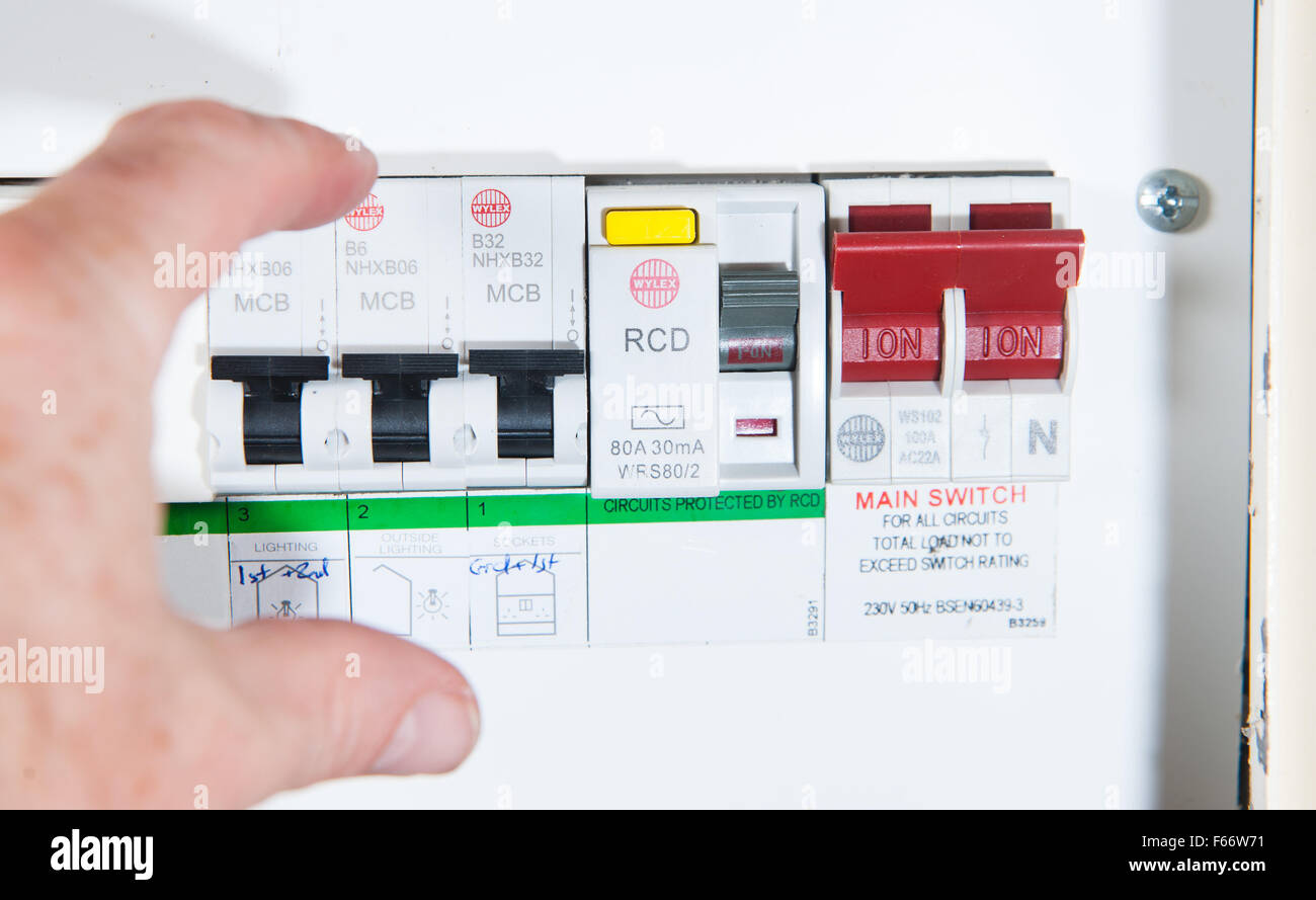 domestic home electrics main fuse box with switch being thrown F66W71 main fuse stock photos & main fuse stock images alamy