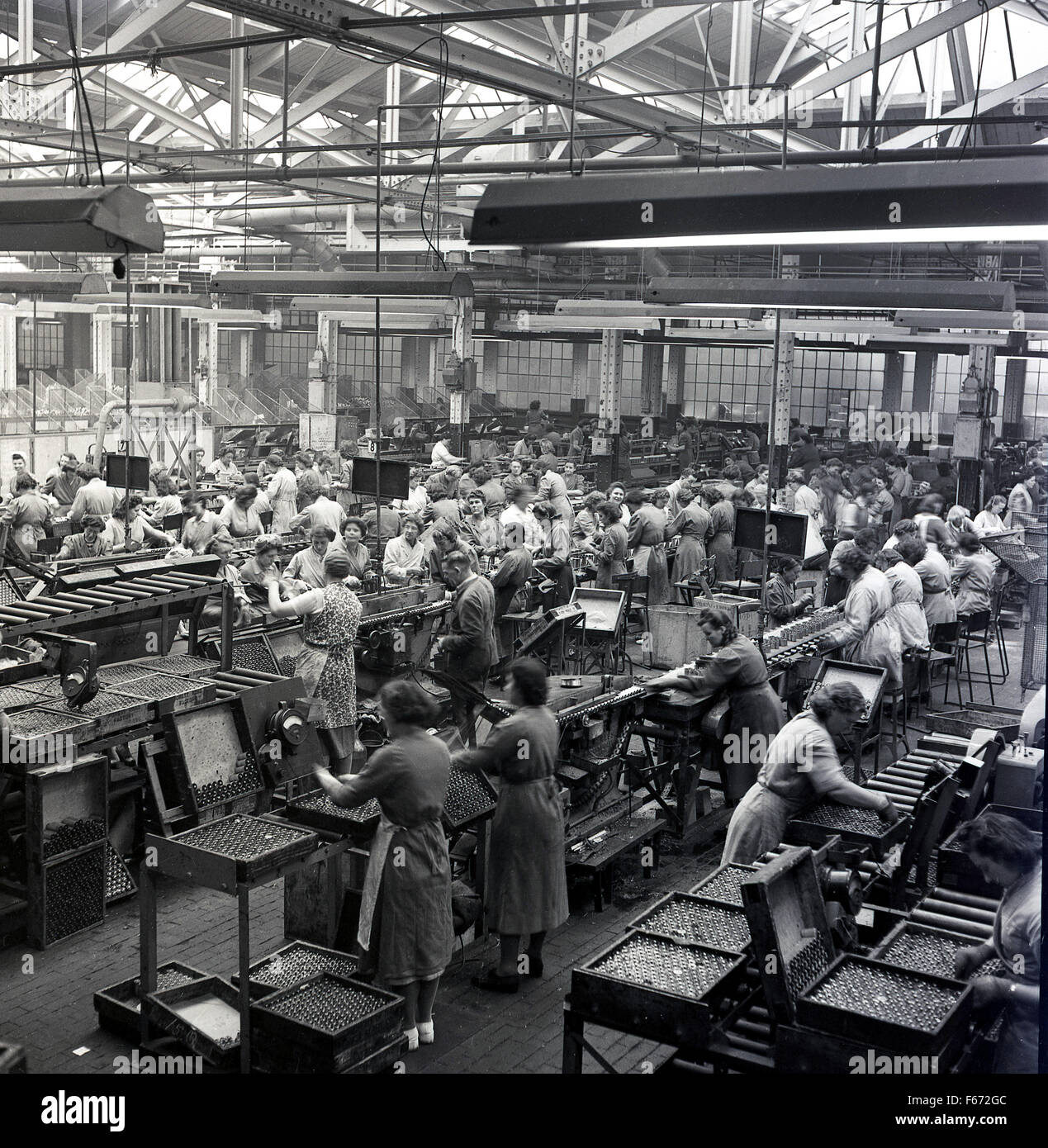 1950s Historical Female Workers On The Factory Floor Of Ever Ready Battery Company England UK