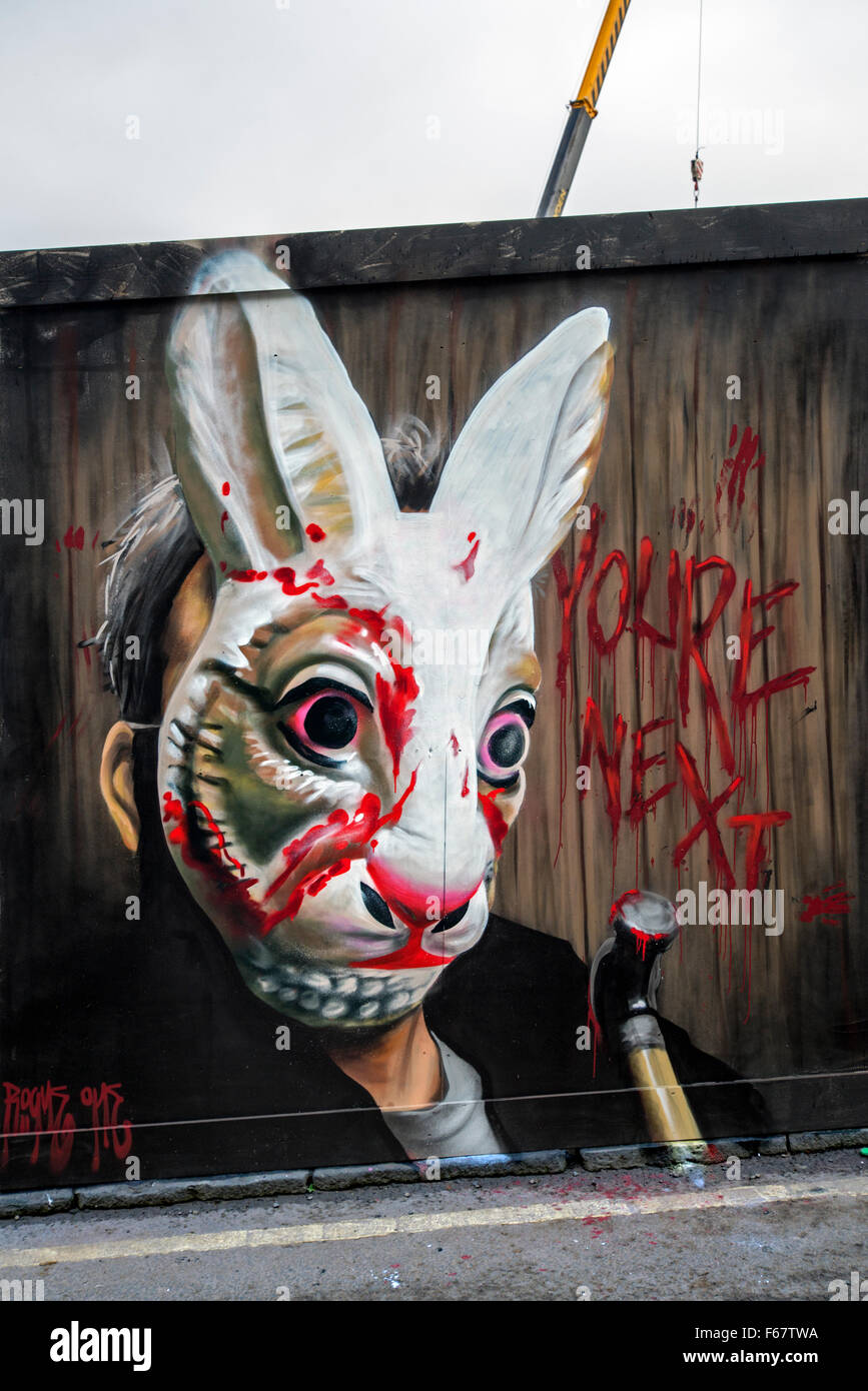 Halloween graffiti featuring a man in a bloodied rabbit mask and ...