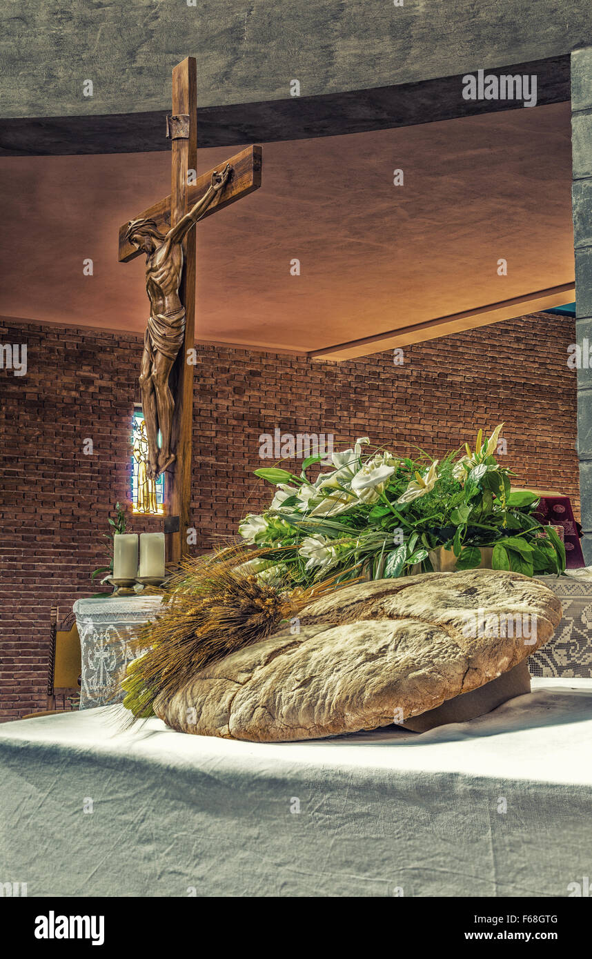 Bread grapes and ears of wheat as a symbol of christian holy bread grapes and ears of wheat as a symbol of christian holy communion in italian catholic church wood statue of the crucifixion of jesus christ in the biocorpaavc
