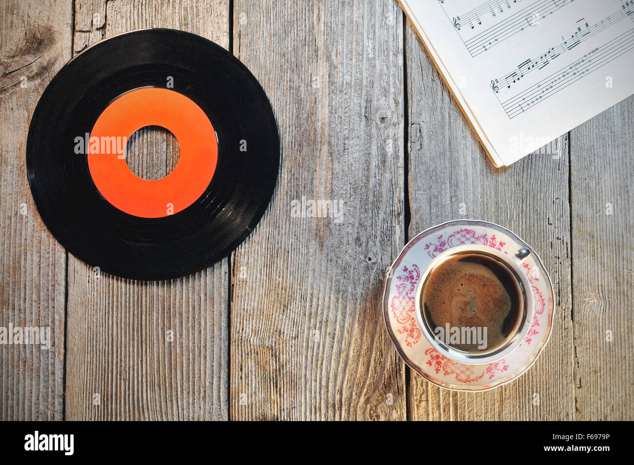 Old vinyl record cup of coffee and music notes on a wooden table old vinyl record cup of coffee and music notes on a wooden table geotapseo Images