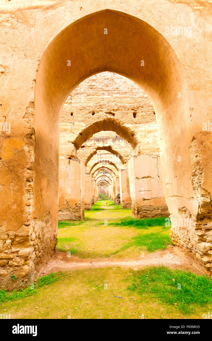 old moroccan granary in the green grass and archway wall Stock ... for Moroccan Archway  150ifm