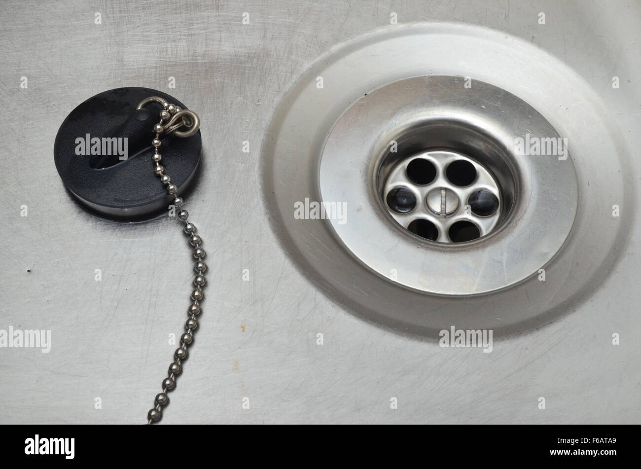 kitchen sink plug hole stock photo, royalty free image: 89978401