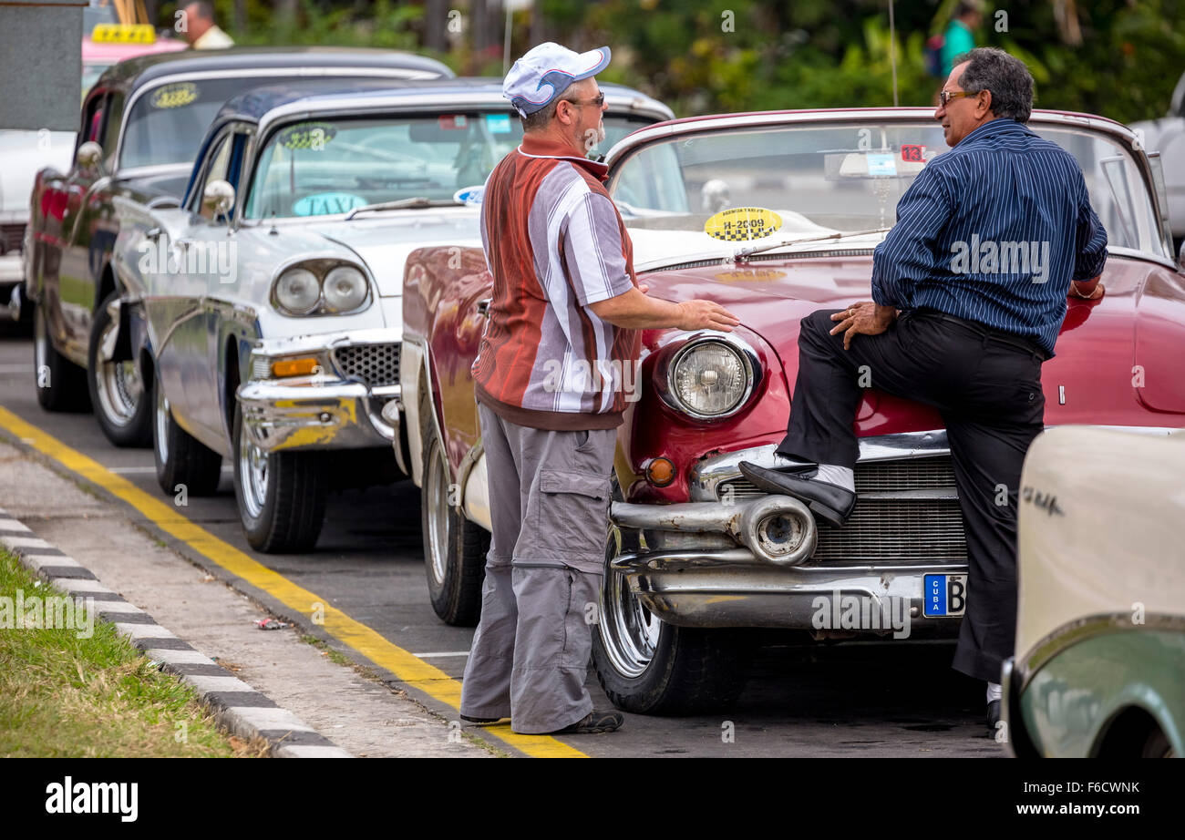 Cuban taxi drivers to their old American limousines, vintage cars ...