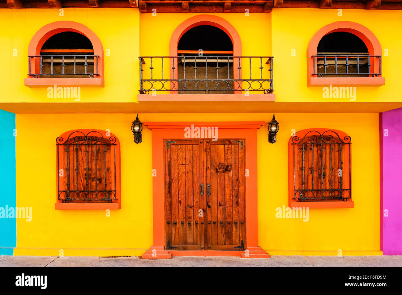 Exterior of Mexican house with wooden door and windows, Puerto Vallarta,  Mexico