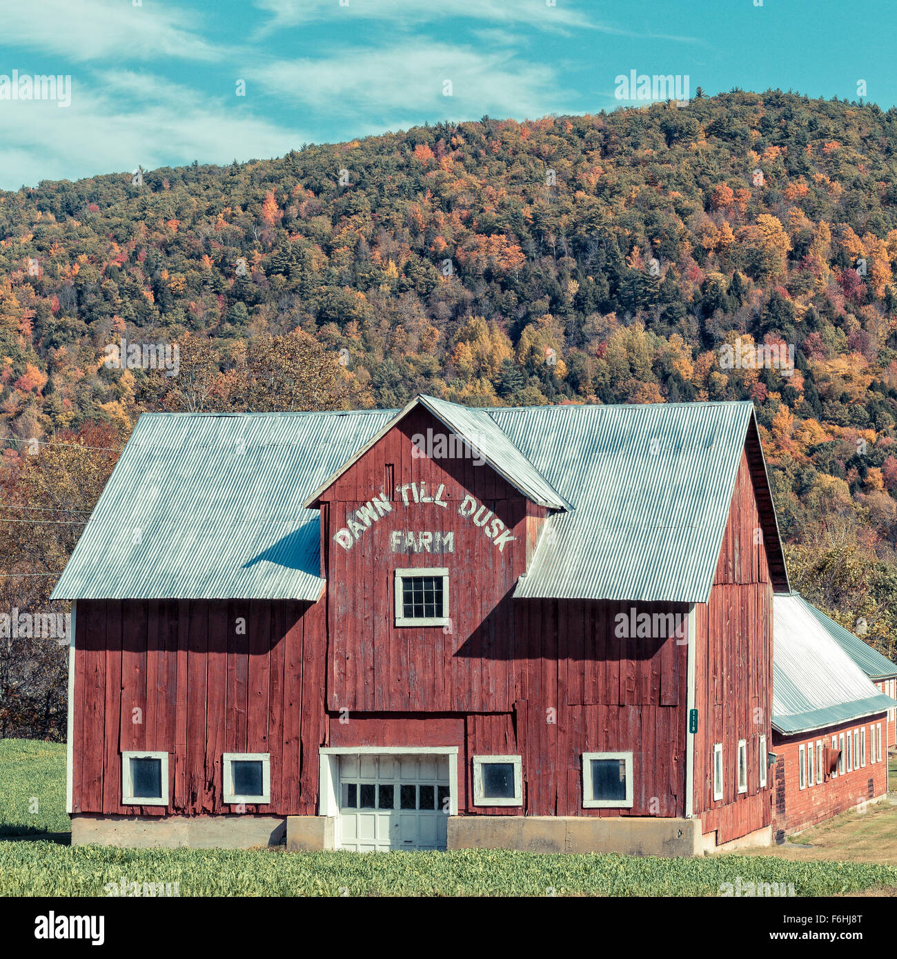 Old Red Barn In Vermont With The Words Dawn Till Dusk Farm Painted On Side