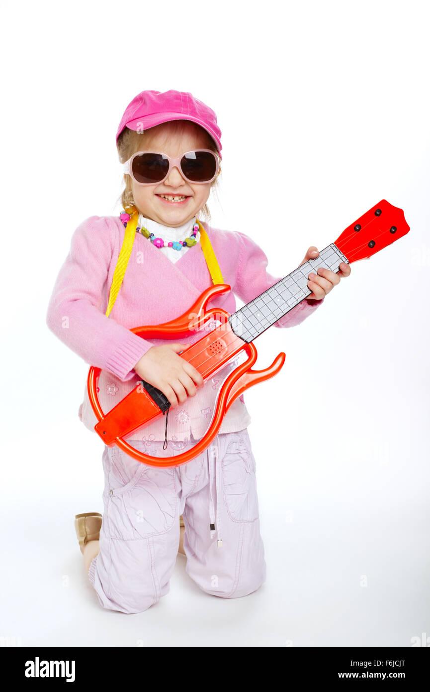 preteen hardcore little girl playing electric guitar hardcore - Stock Image