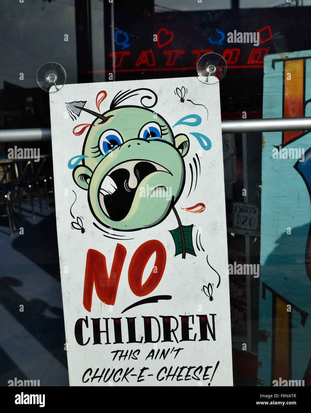 Cartoon sign telling customers that no children are for Age limit for tattoos