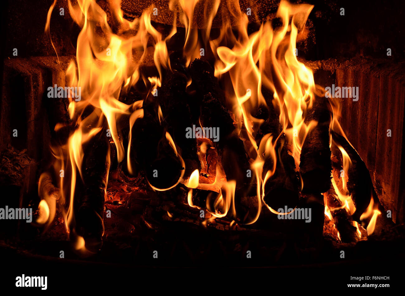 Hot vivid burning birch logs in fireplace on a cold winter day ...