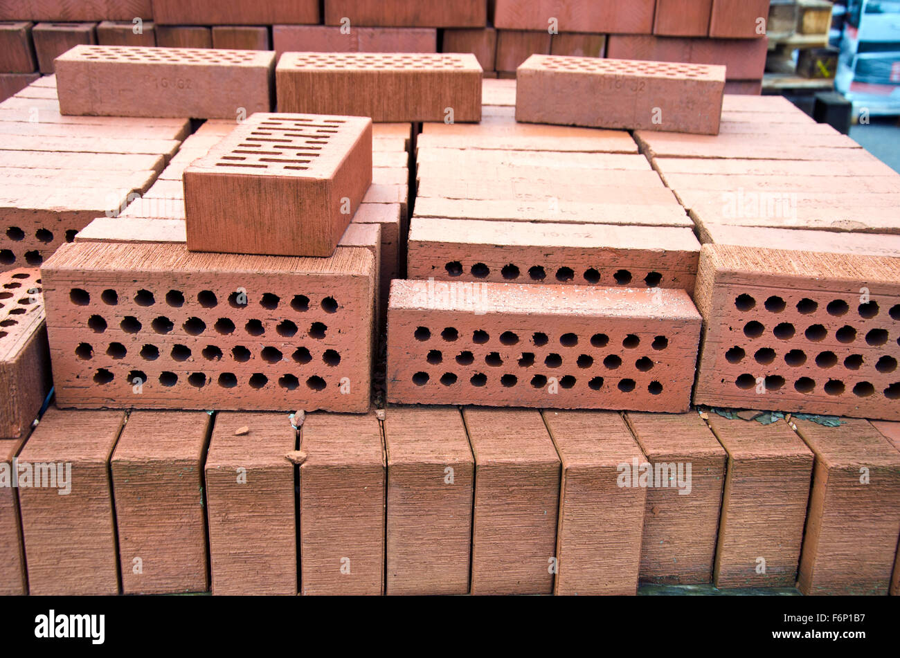 Stack Of Red Clay Bricks With Holes In Market