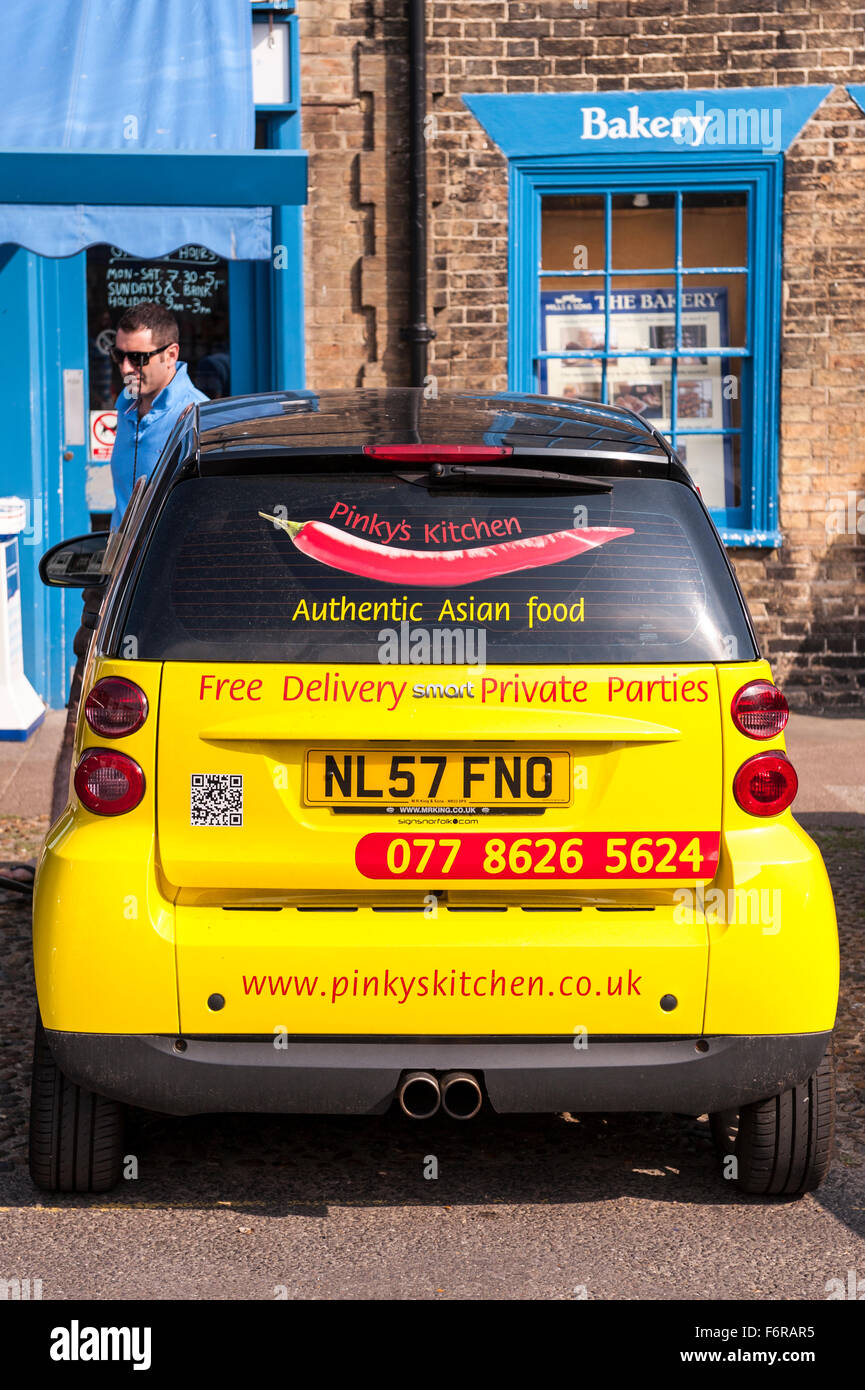 Smart car sticker designs - A Smart Car Covered In Advertising Stickers In The Uk