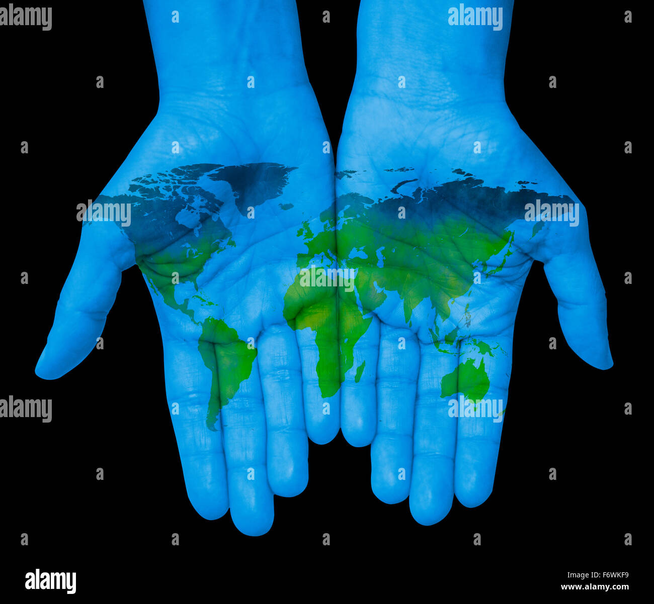 The world in your hands with world map stock photo royalty free the world in your hands with world map gumiabroncs Gallery