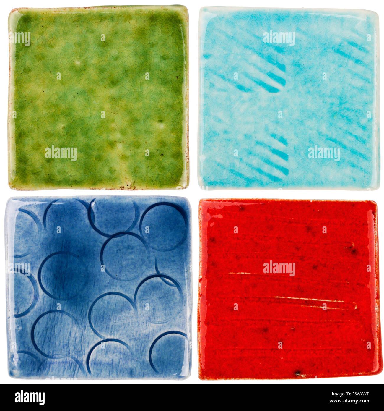 Handmade glazed ceramic tiles isolated on white stock photo handmade glazed ceramic tiles isolated on white dailygadgetfo Choice Image