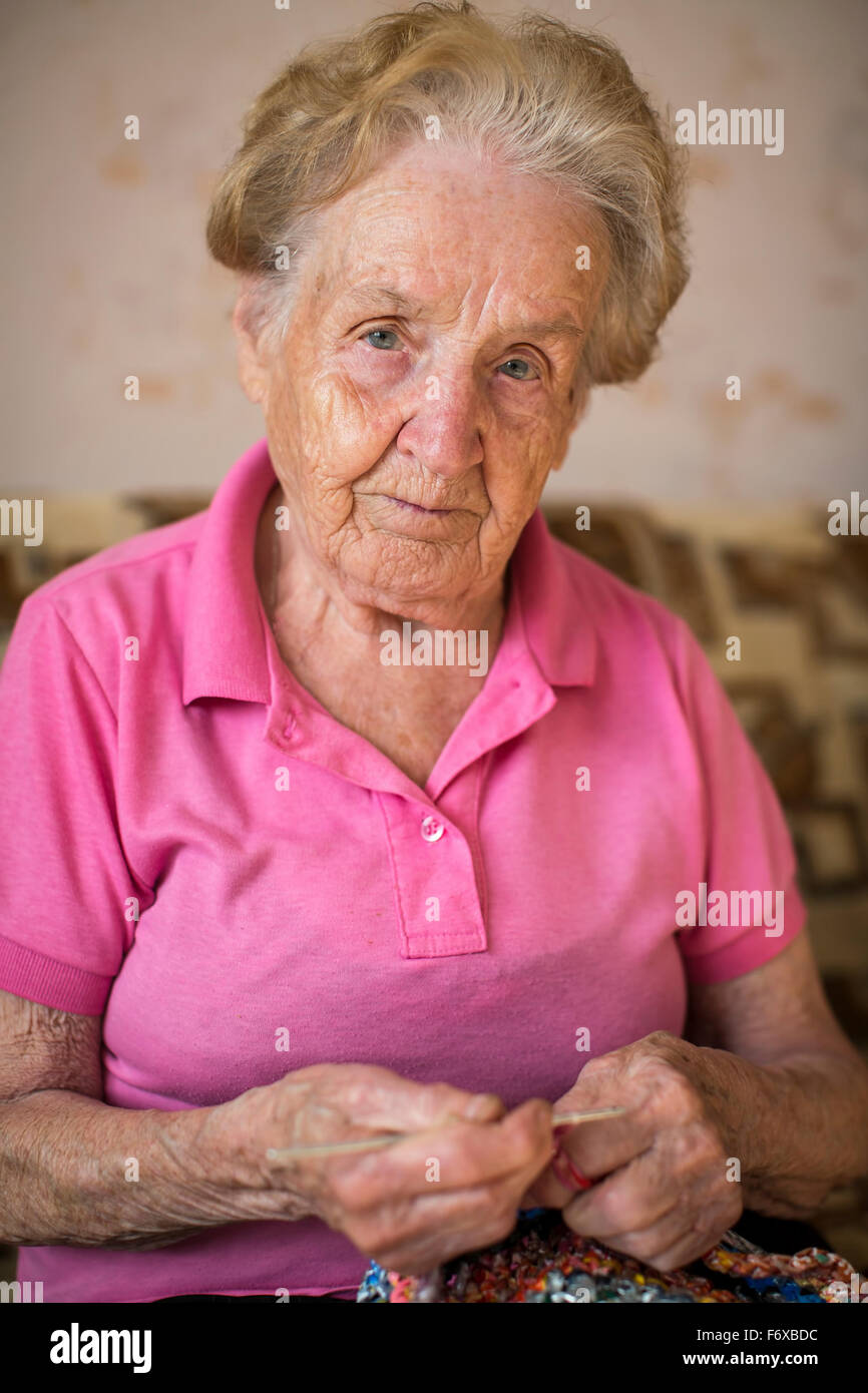 Old Knitting Woman : Old woman sitting and knitting grandmother stock photo