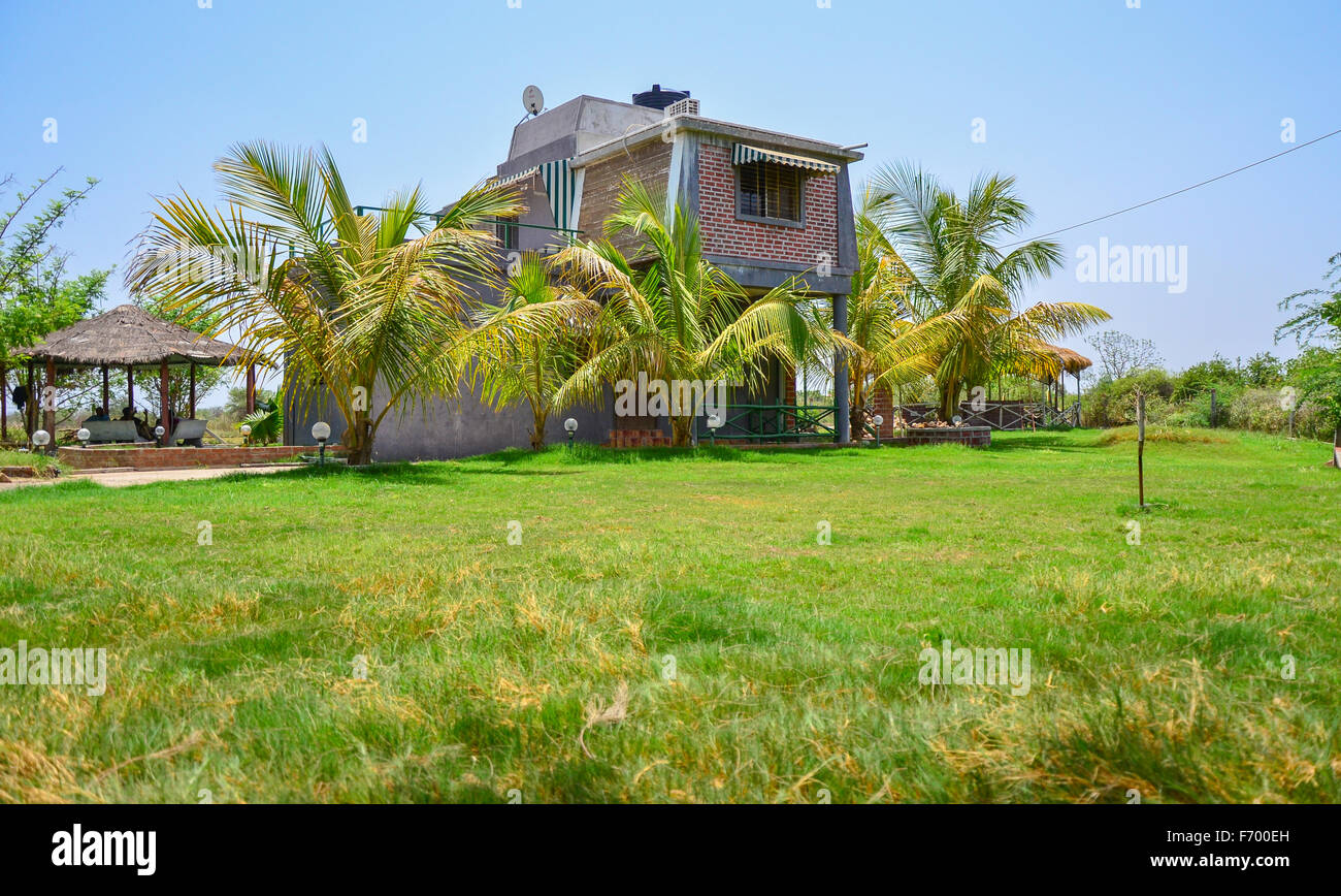 Side yard view of a 2 bhk farm house in chansad vadodara for Architecture design for home in vadodara