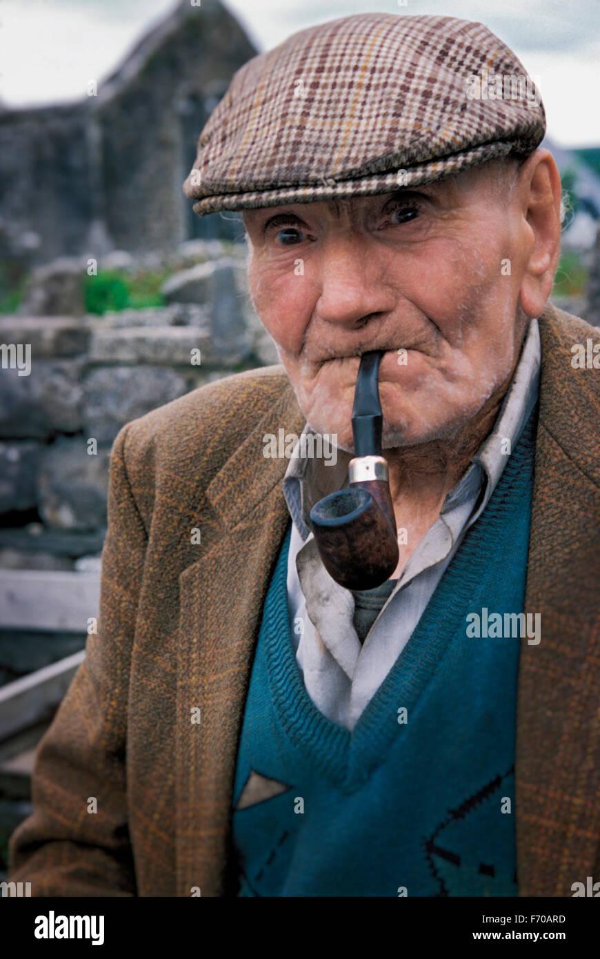 Irish man with pipe. The Burren, Ireland Stock Photo ...