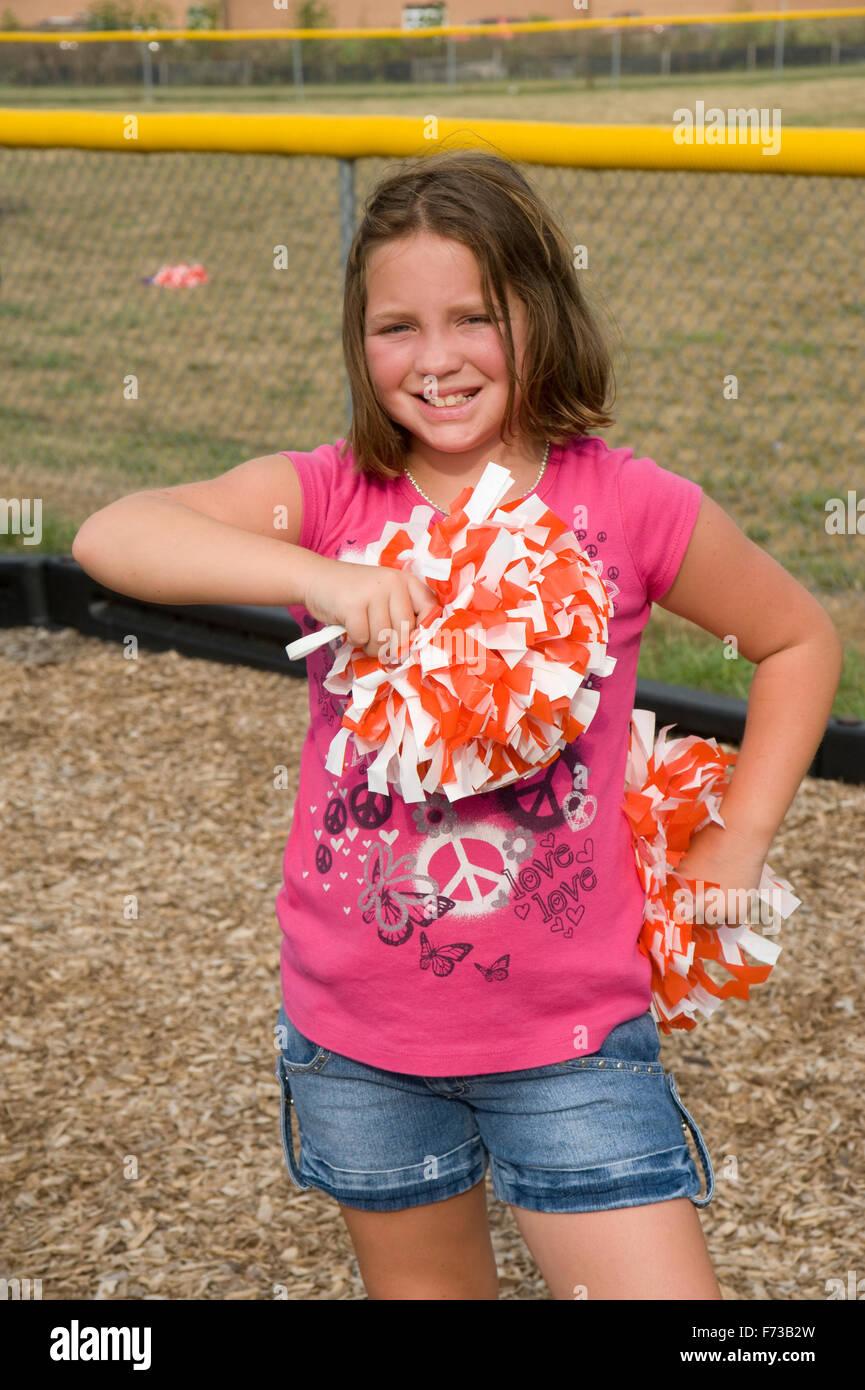 Young Pre Teen Girl Female Woman Torso Vertical Format: Pre-teen Girl At Cheerleading Practice Stock Photo