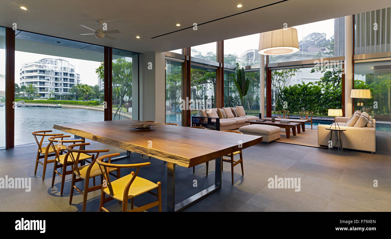 open plan living and dining room in cove way house, sentosa stock