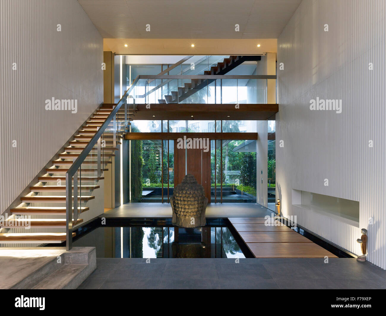 Open Plan Entrance Hall And Staircase With Pool Of Water